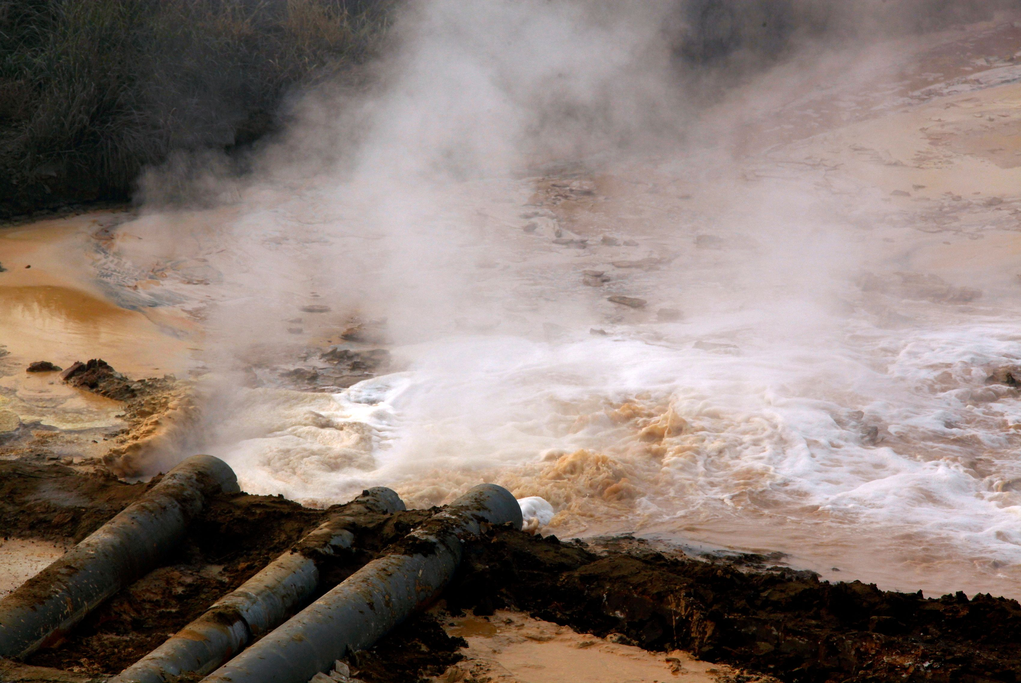 Pipes coming from a rare earth smelting plant spew polluted water into a vast tailings dam near Xinguang Village, located on the outskirts of the city of Baotou in China's Inner Mongolia Autonomous Region in this October 31, 2010 picture.   REUTERS/David Gray/File Photo