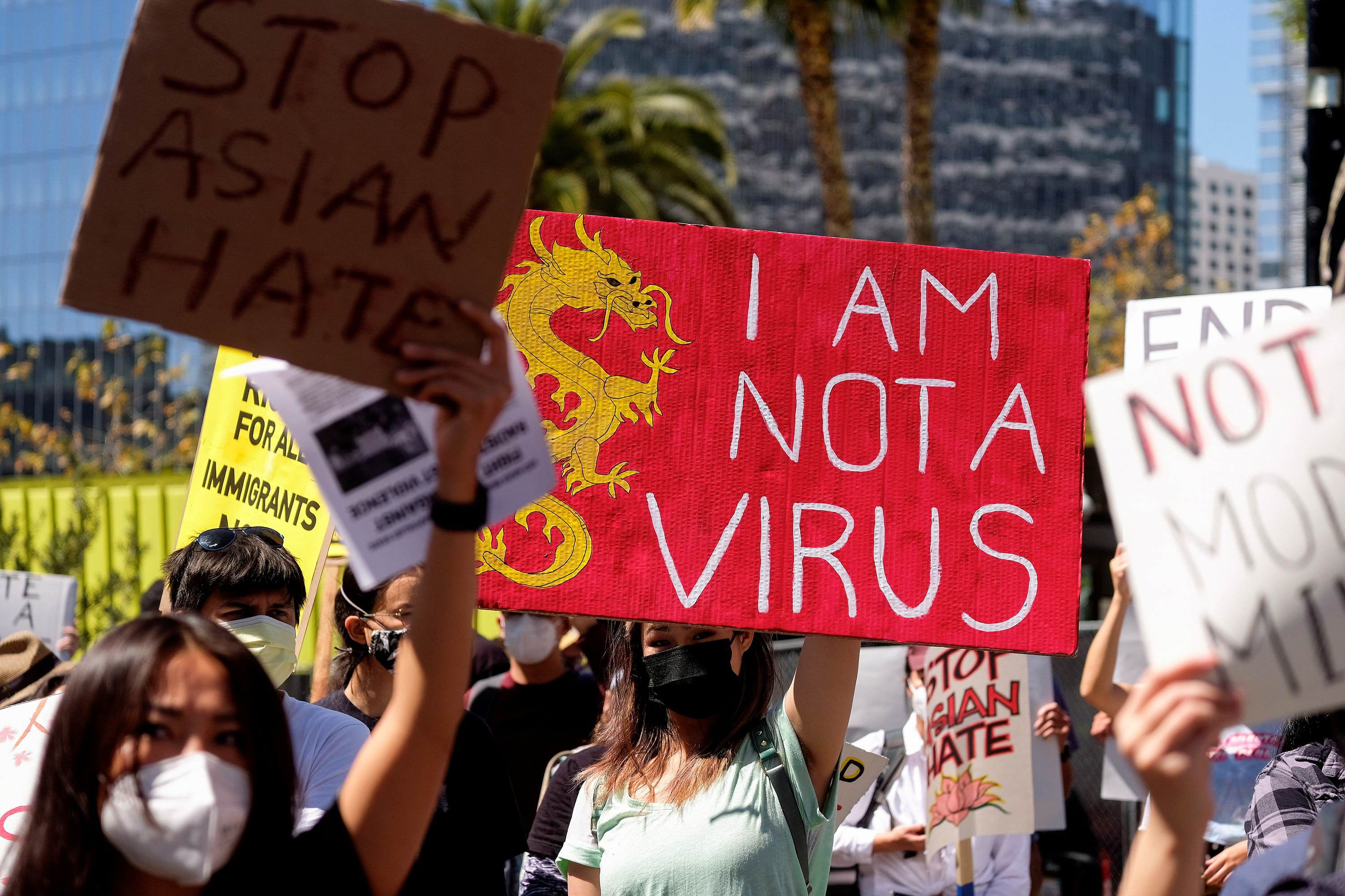 Demonstrators hold signs during a rally against anti-Asian hate crimes outside City Hall in Los Angeles, California, U.S. March 27, 2021. REUTERS/Ringo Chiu/File Photo