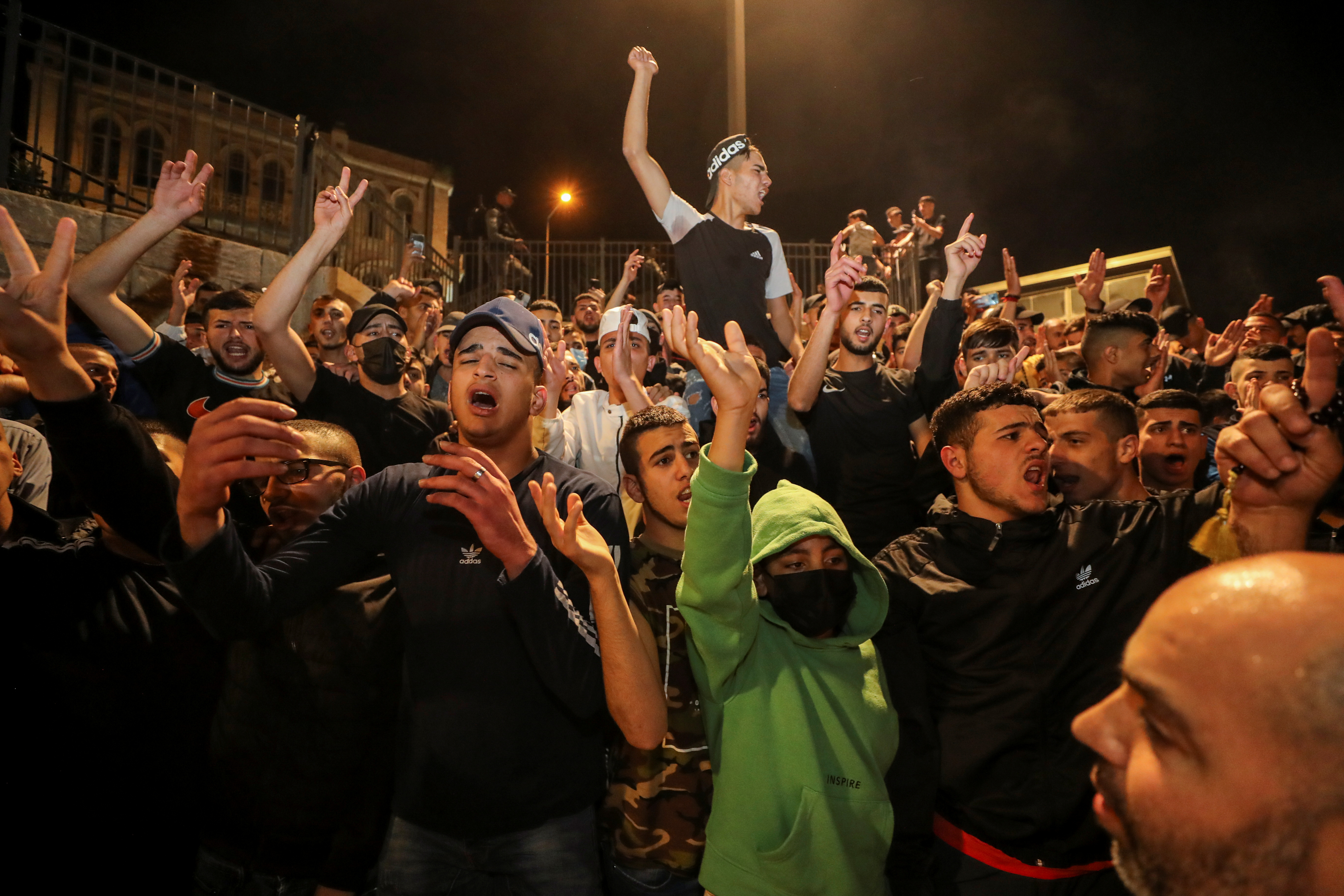 Palestinians celebrate outside Damascus Gate after barriers that were put up by Israeli police are removed, allowing access to the main square that has been the focus of a week of clashes around Jerusalem's Old City April 25, 2021. REUTERS/Ammar Awad