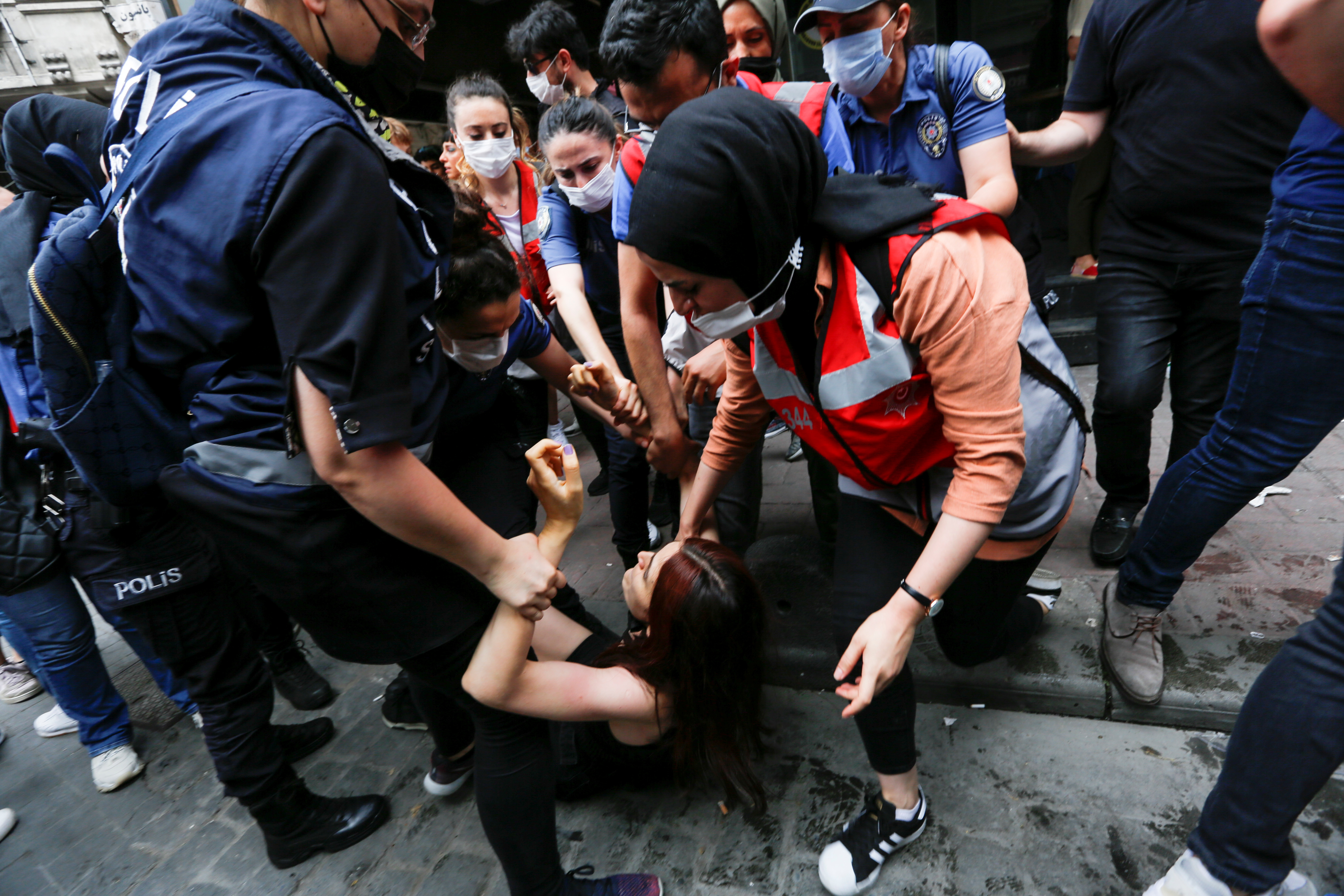 Riot police detain a demonstrator as LGBT rights activists try to gather for a Pride parade, which was banned by local authorities, in central in Istanbul, Turkey June 26, 2021. REUTERS/Dilara Senkaya