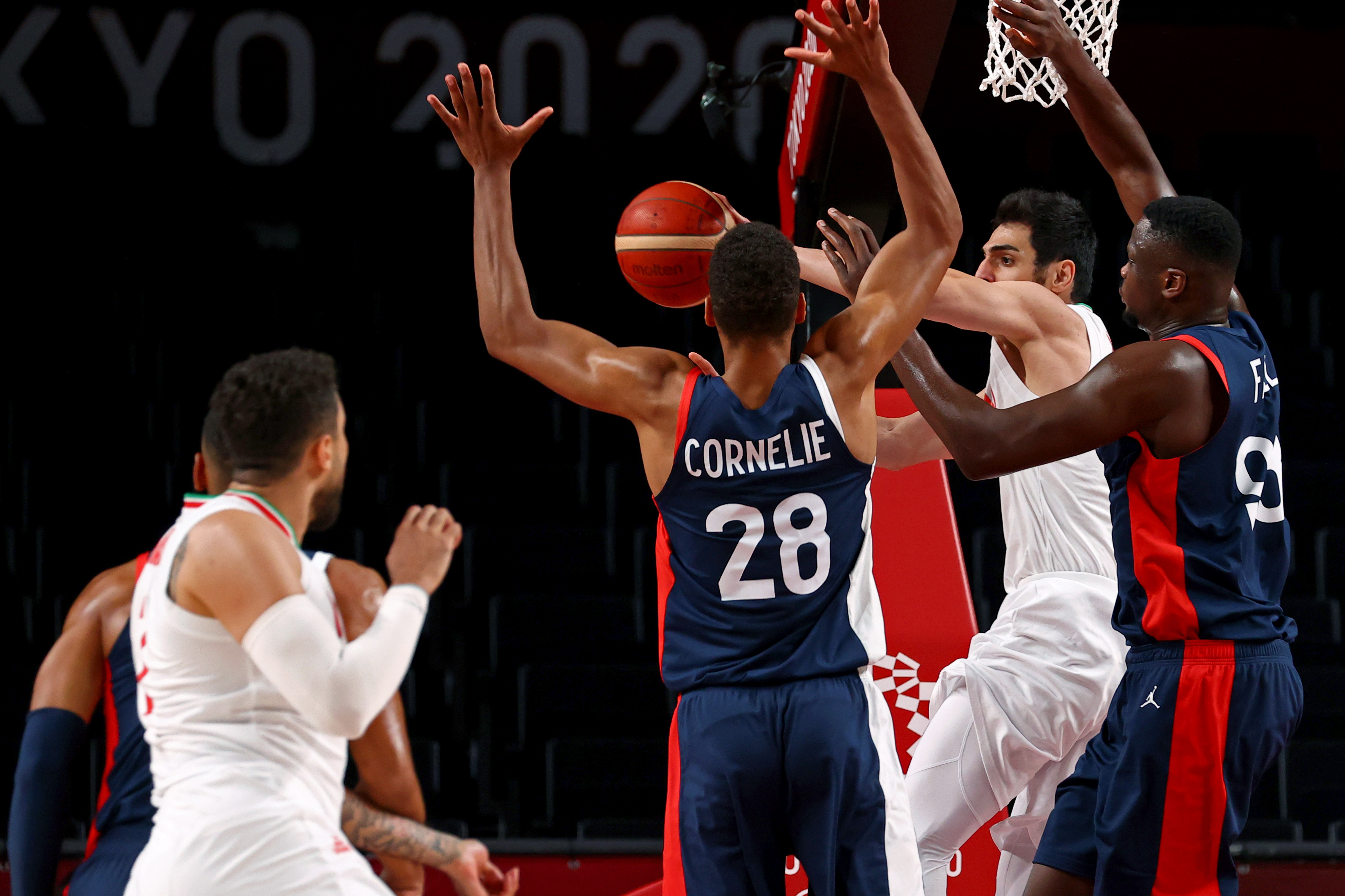 Tokyo 2020 Olympics - Basketball - Men - Group A - Iran v France - Saitama Super Arena, Saitama, Japan - July 31, 2021. Navid Rezaeifar of Iran in action with Moustapha Fall of France and Petr Cornelie of France REUTERS/Brian Snyder