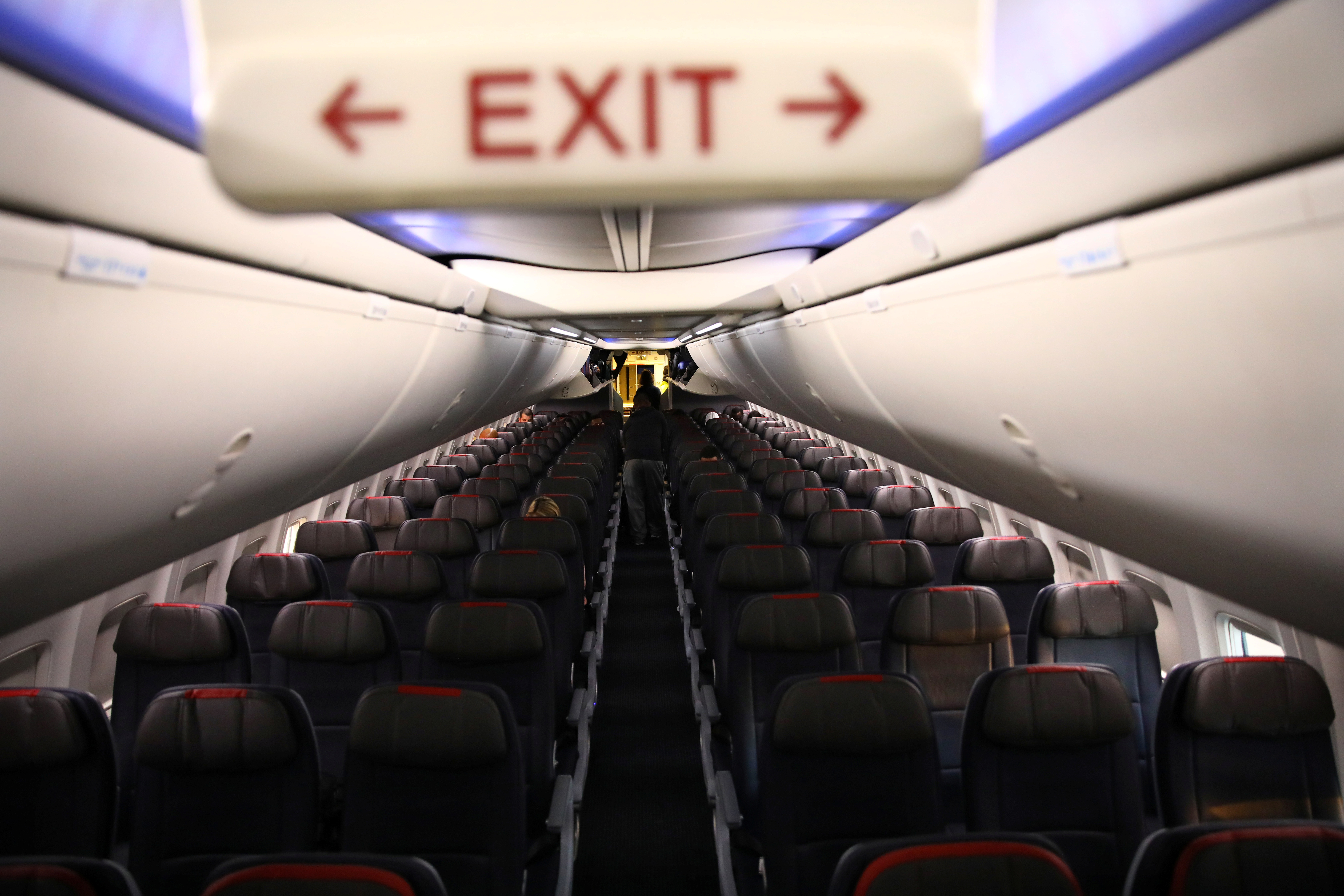 Rows of empty seats of an American Airline flight are seen, as coronavirus disease (COVID-19) disruption continues across the global industry, during a flight between Washington D.C. and Miami, in Washington, U.S., March 18, 2020. REUTERS/Carlos Barria