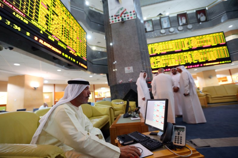 An investor monitors a screen displaying stock information at the Abu Dhabi Securities Exchange June 25, 2014./File Photo