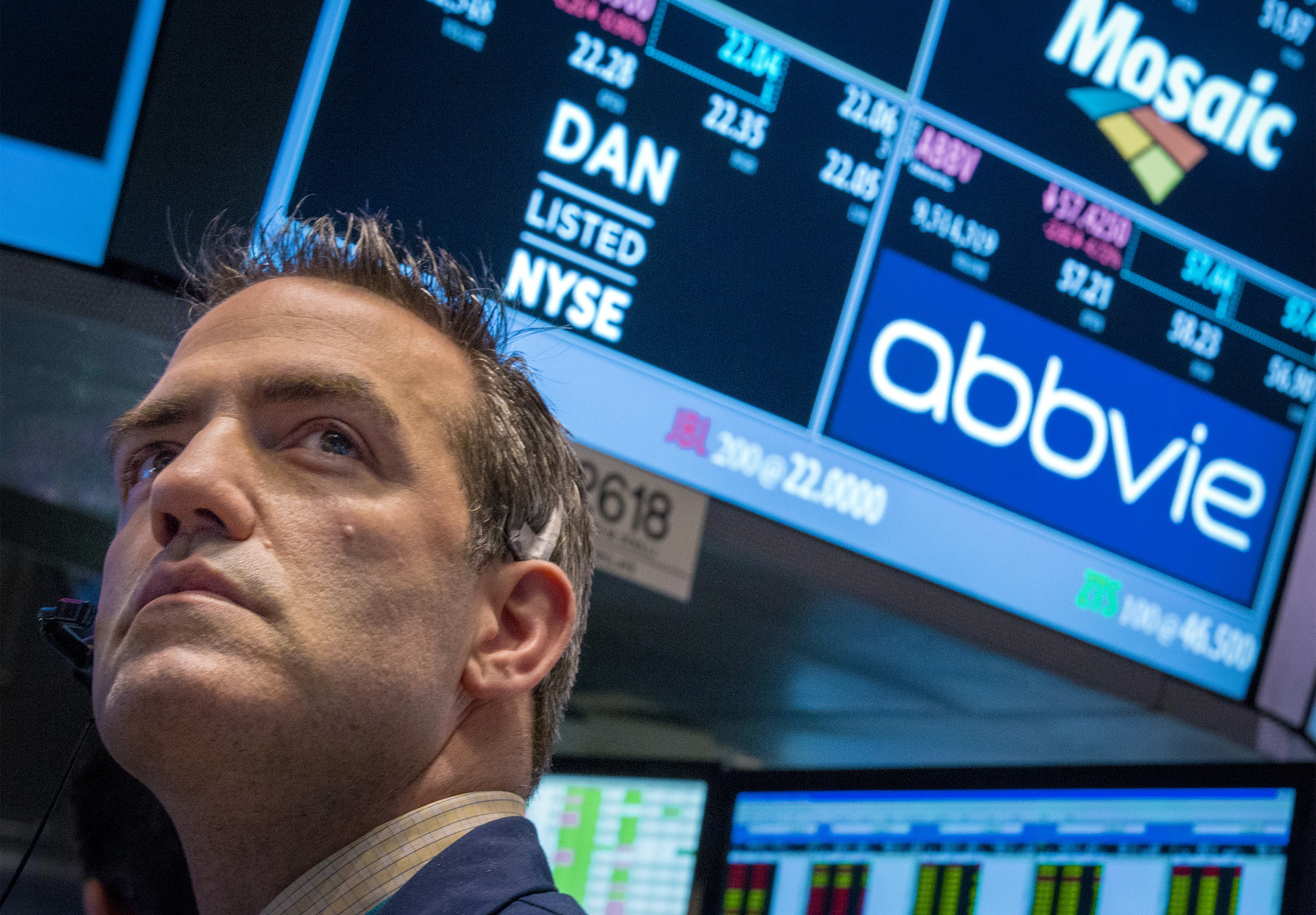 A trader works by the post that trades AbbVie on the floor of the New York Stock Exchange March 5, 2015. AbbVie Inc said on Thursday it fought two other drugmakers to