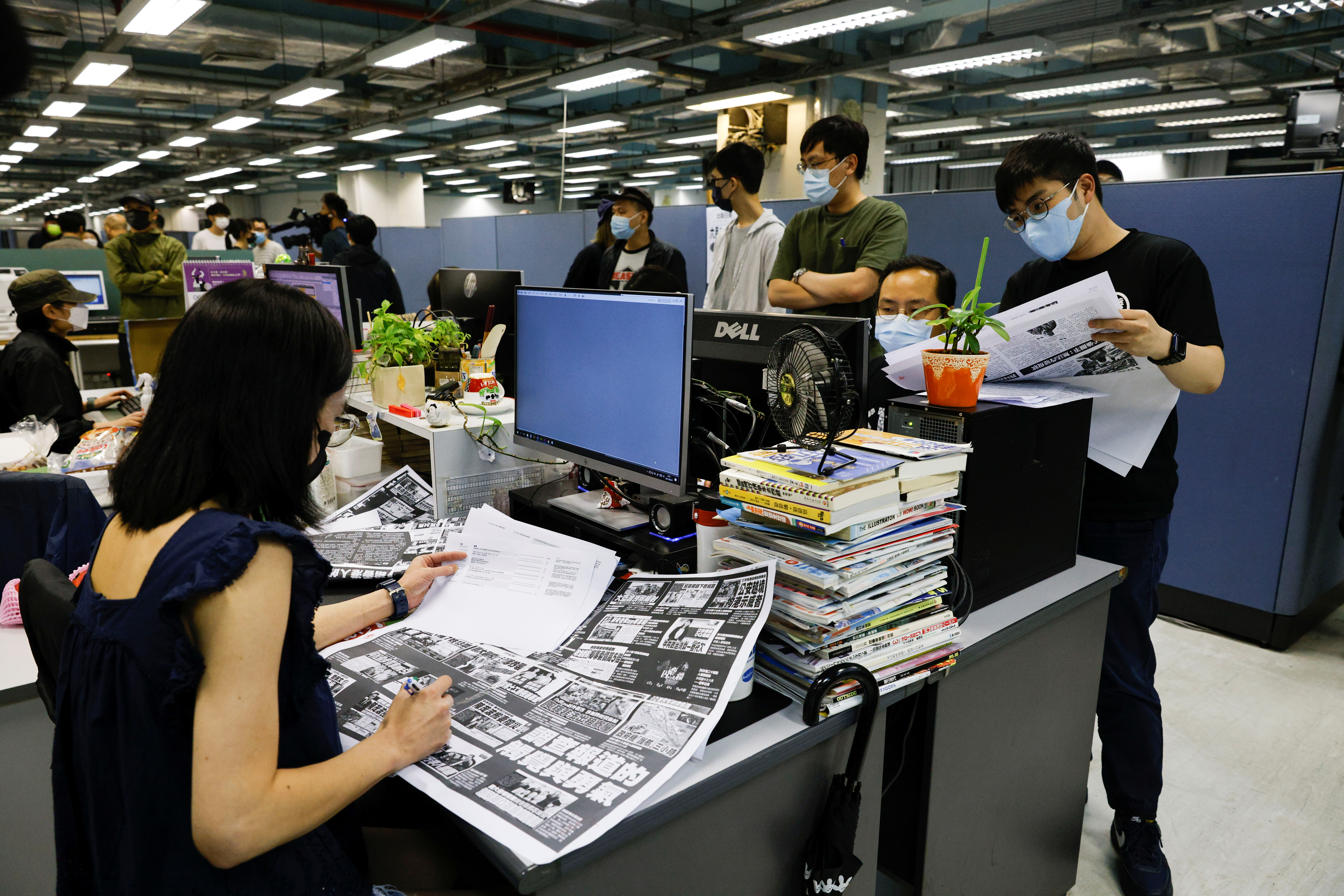 Staff members of Apple Daily and its publisher Next Digital work on the final edition of their newspaper in Hong Kong, China June 23, 2021. REUTERS/Lam Yik