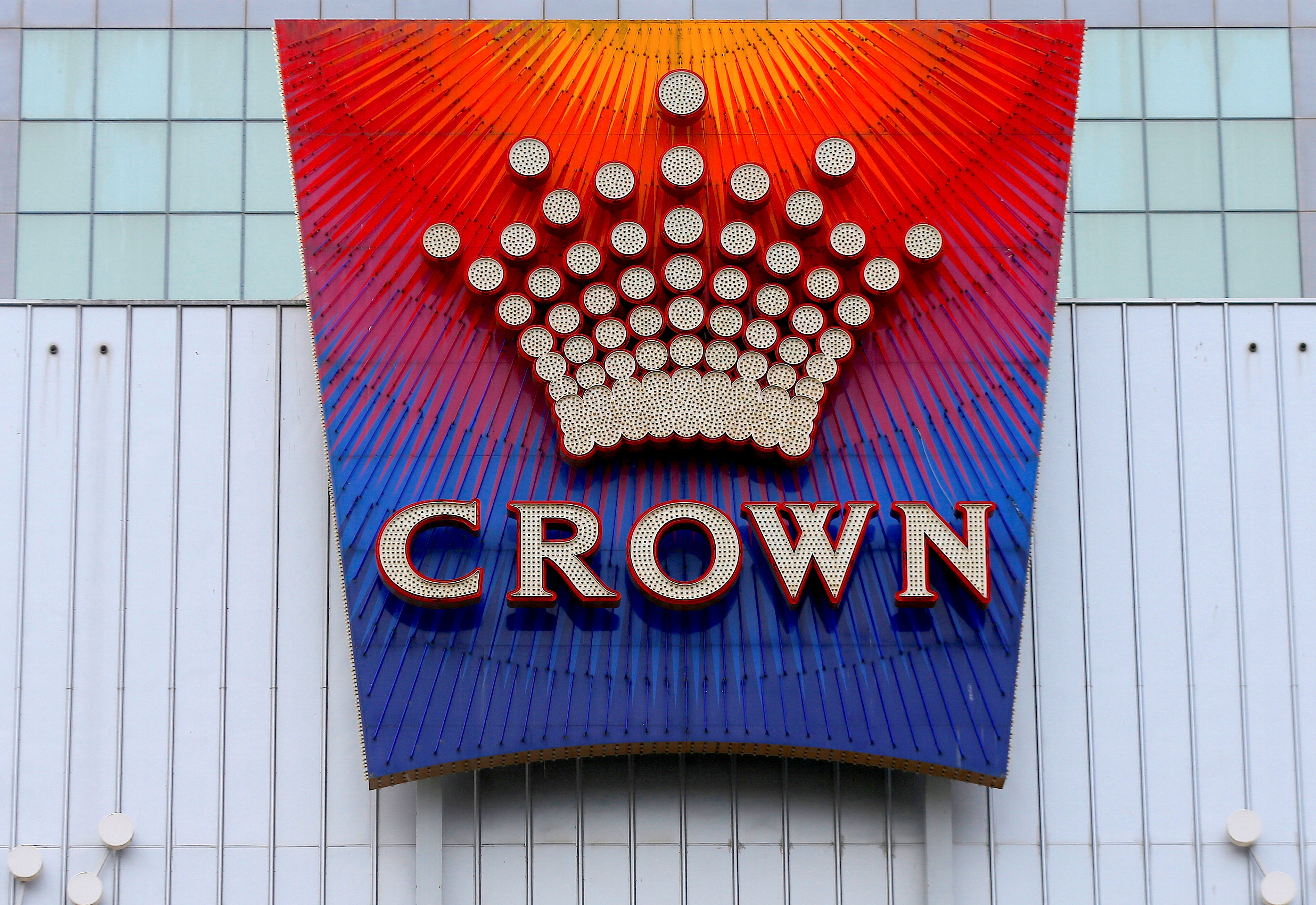 The logo of Australian casino giant Crown Resorts Ltd adorns the hotel and casino complex in Melbourne, Australia, June 13, 2017.       REUTERS/Jason Reed