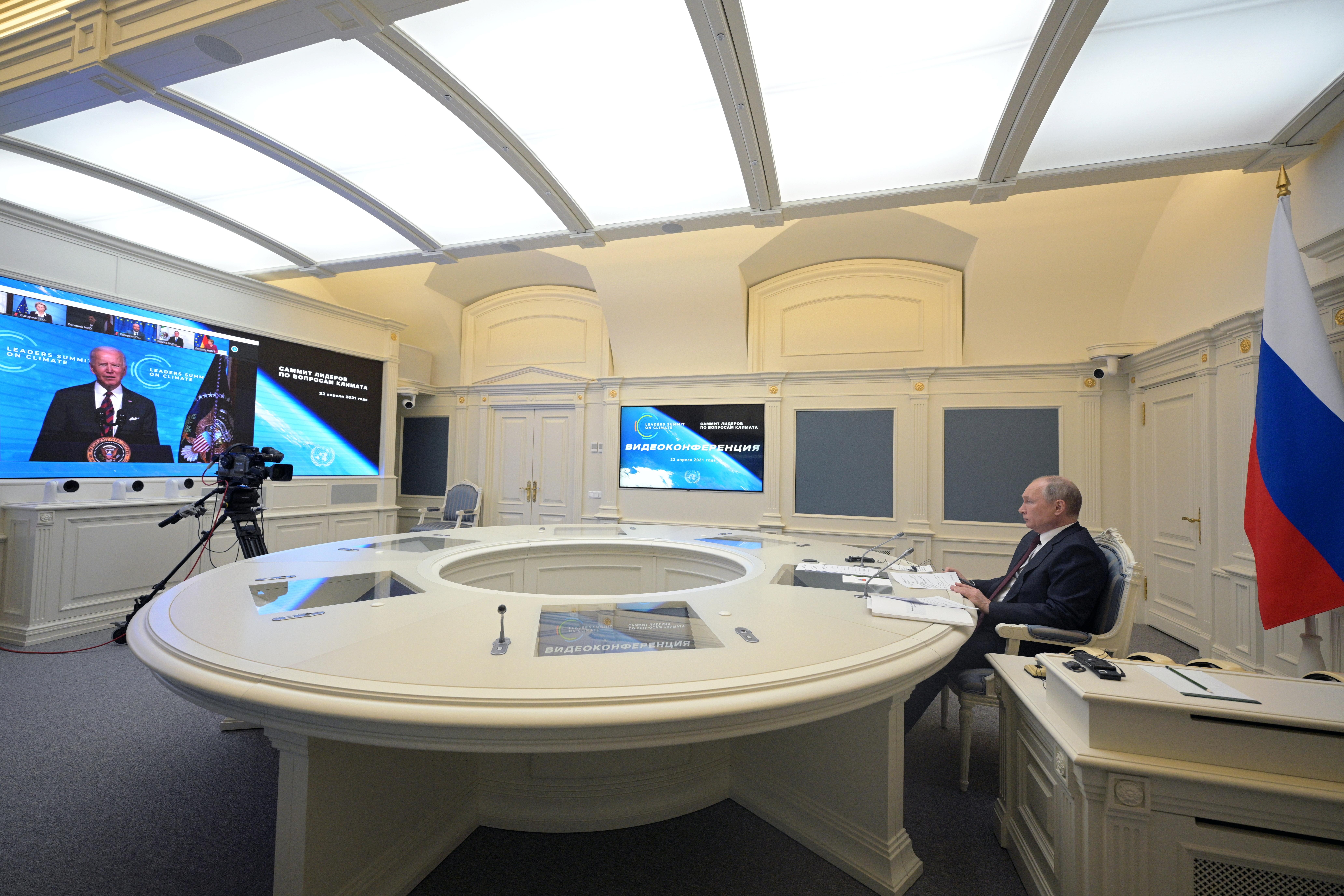 Russian President Vladimir Putin listens to U.S. President Joe Biden as he attends a virtual global climate summit via a video link in Moscow, Russia April 22, 2021. Sputnik/Alexei Druzhinin/Kremlin via REUTERS