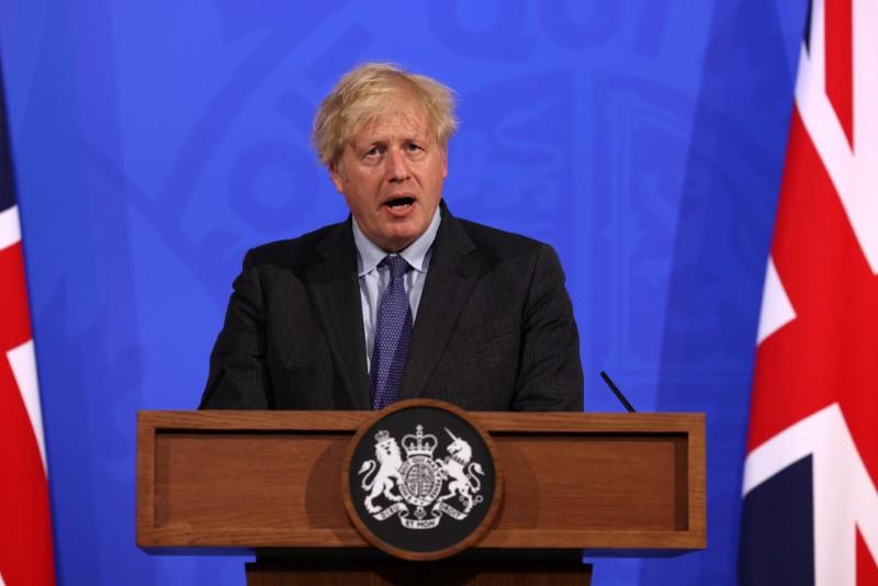 British Prime Minister Boris Johnson holds a news conference regarding England's COVID-19 lockdown easing delay in London, Britain June 14, 2021. Jonathan Buckmaster/Pool via REUTERS