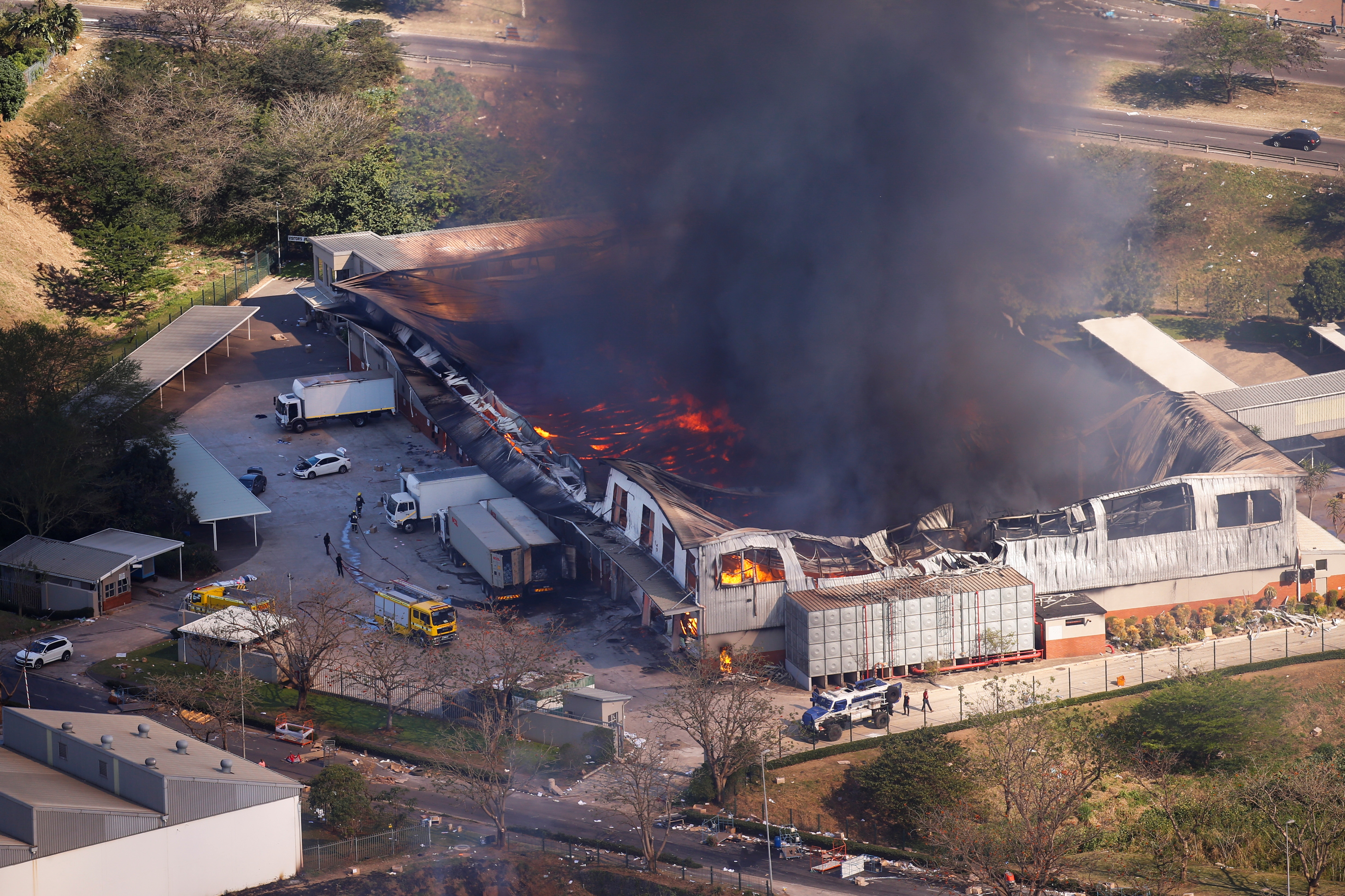 A general view of the burning warehouse after violence erupted following the jailing of former South African President Jacob Zuma, in Durban, South Africa, July 14, 2021. REUTERS/Rogan Ward