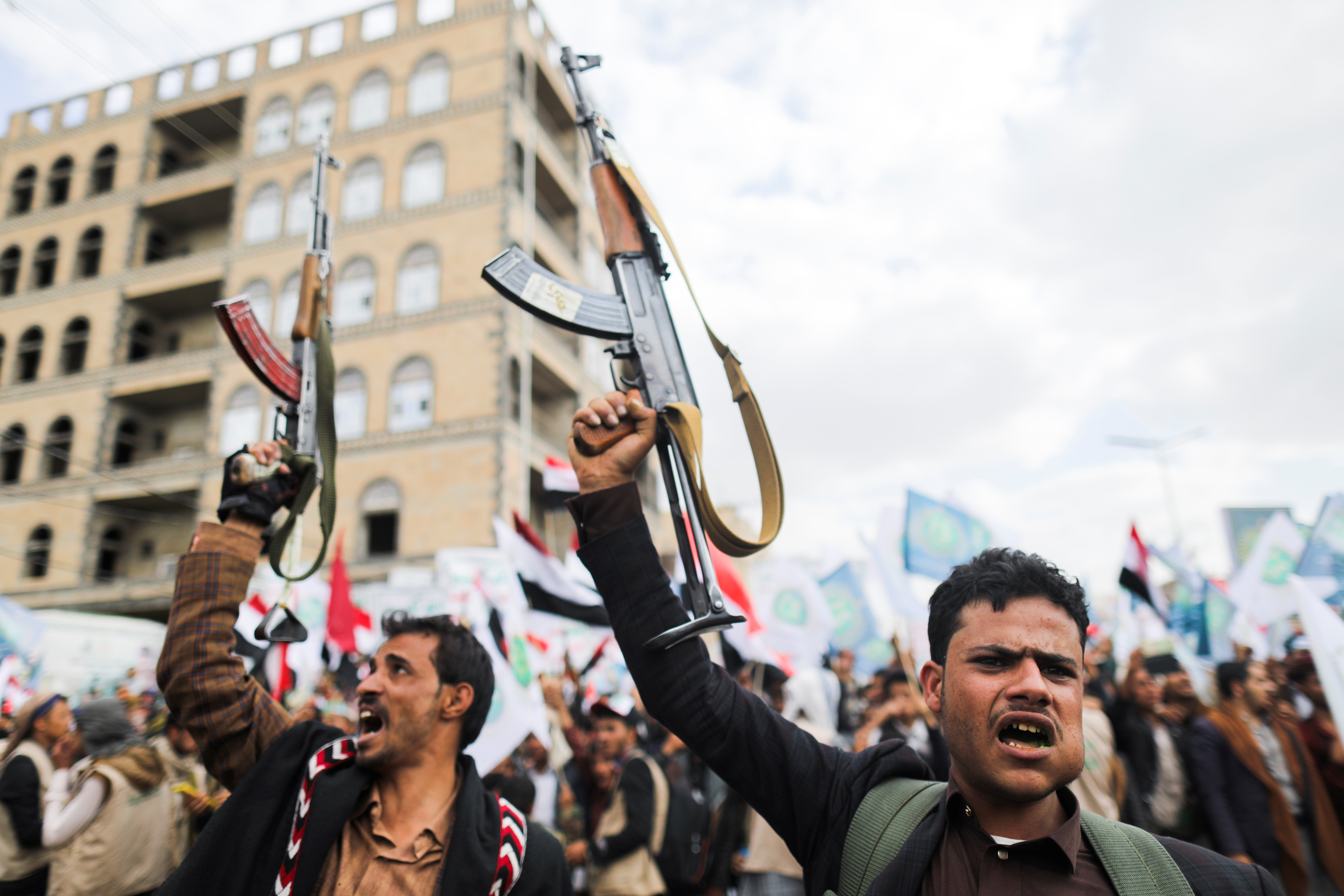 Supporters of Yemen's Houthis hold up their rifles as they rally to celebrate the seventh anniversary of the ousting of the government in Sanaa, Yemen September 21, 2021. REUTERS/Khaled Abdullah