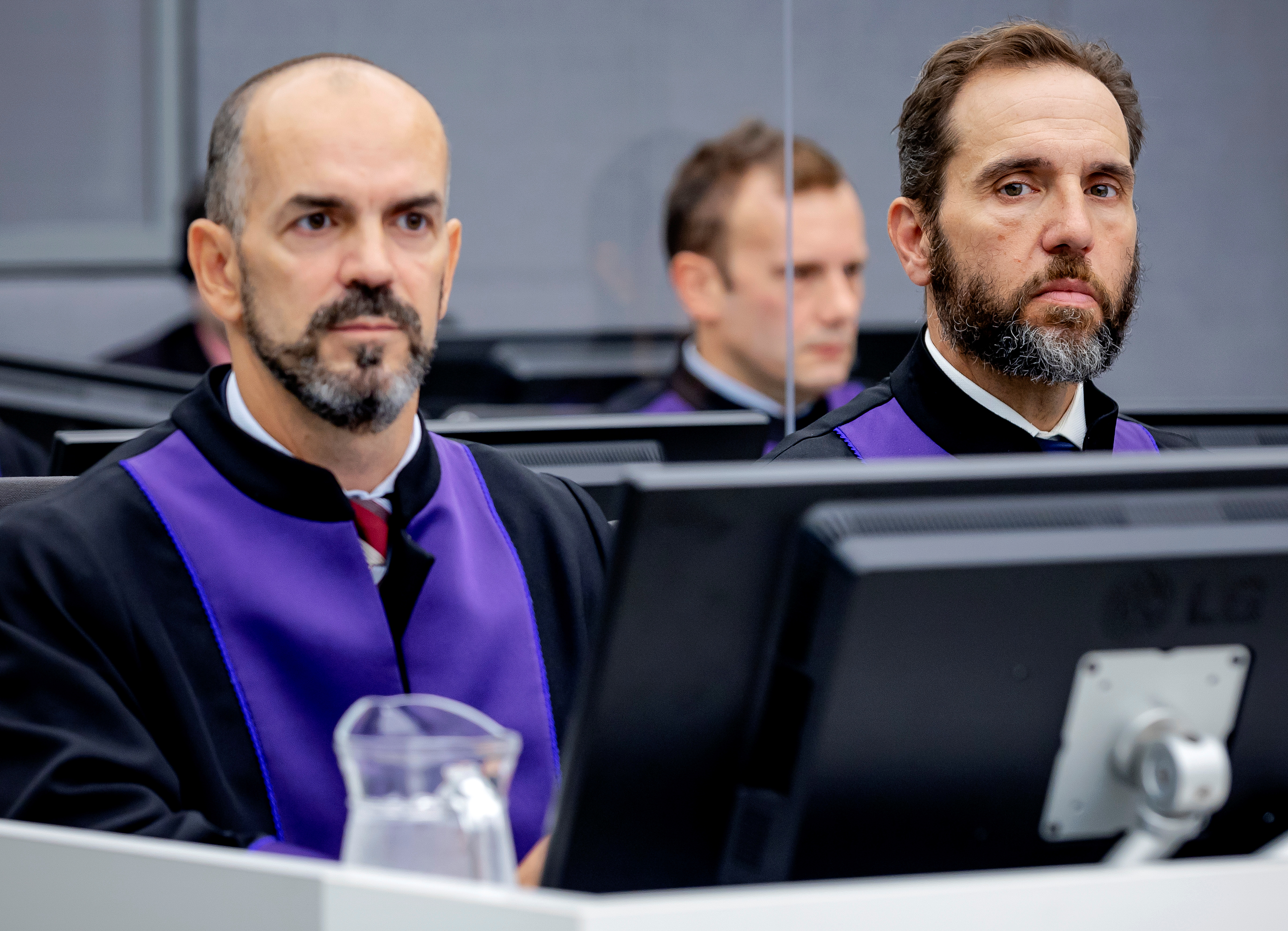 Prosecutors Cezary Michalczuk and Jack Smith look on during the start of trial of former KLA officer Salih Mustafa, accused of murder, torture and cruel treatment during the 1998-1999 Kosovo conflict, before a special tribunal set up to hear cases of war crimes allegedly committed by the Kosovo Liberation Army (KLA), in The Hague, Netherlands, September 15, 2021. Robin van Lonkhuijsen/ANP/Pool via REUTERS