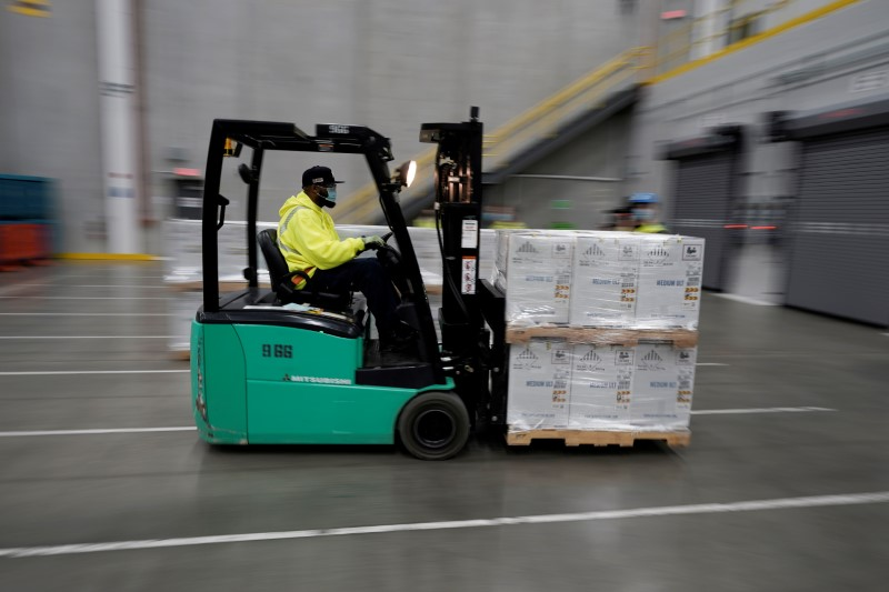 Boxes containing the Pfizer-BioNTech COVID-19 vaccine are prepared to be shipped at the Pfizer Global Supply Kalamazoo manufacturing plant in Portage, Michigan, U.S., December 13, 2020.  Morry Gash/Pool via REUTERS/File Photo