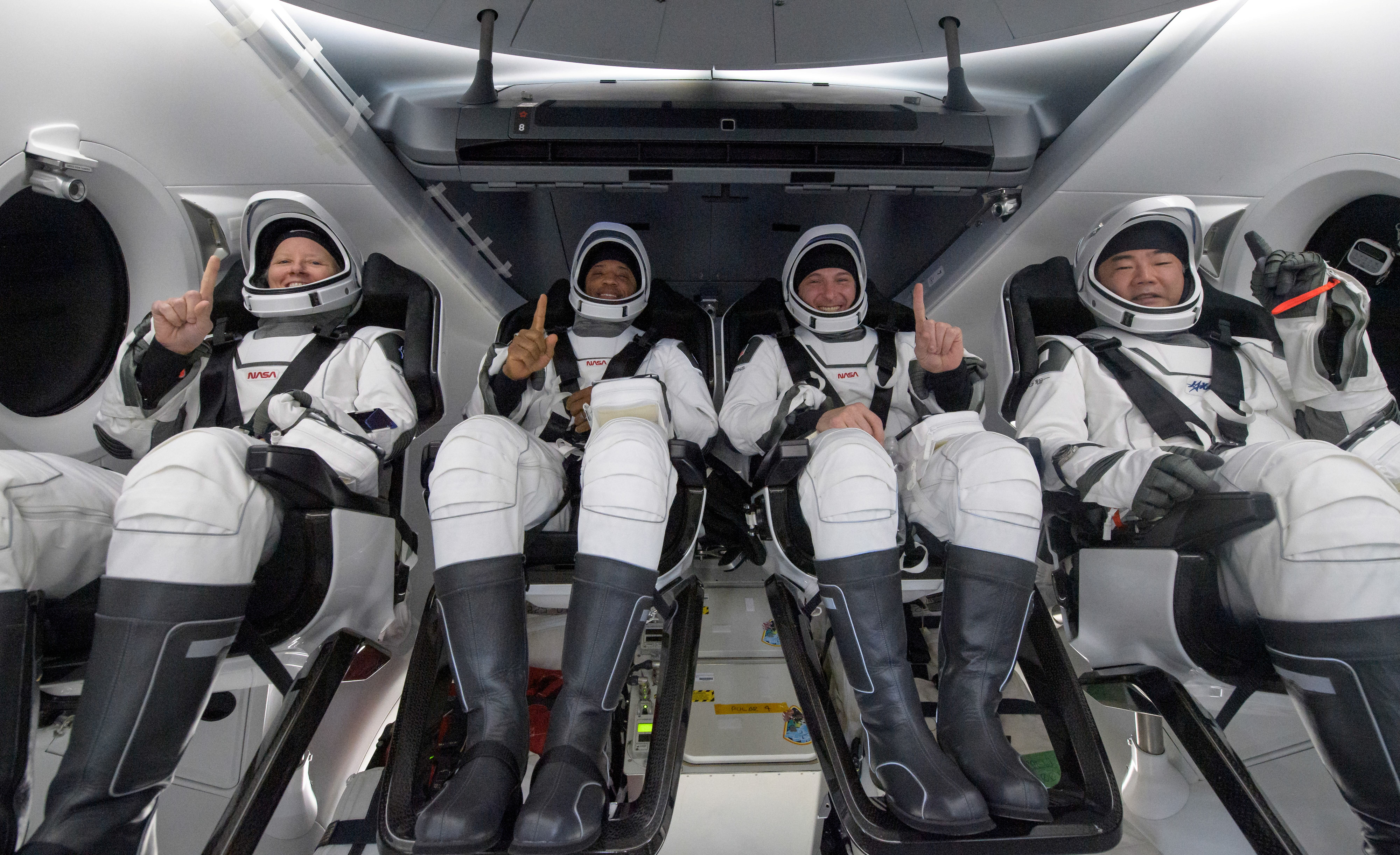 NASA astronauts Shannon Walker, left, Victor Glover, Mike Hopkins, and Japan Aerospace Exploration Agency (JAXA) astronaut Soichi Noguchi react inside the SpaceX Crew Dragon Resilience spacecraft onboard the SpaceX GO Navigator recovery ship shortly after having landed in the Gulf of Mexico off the coast of Panama City, Florida, U.S. May 2, 2021. NASA/Bill Ingalls/Handout via REUTERS