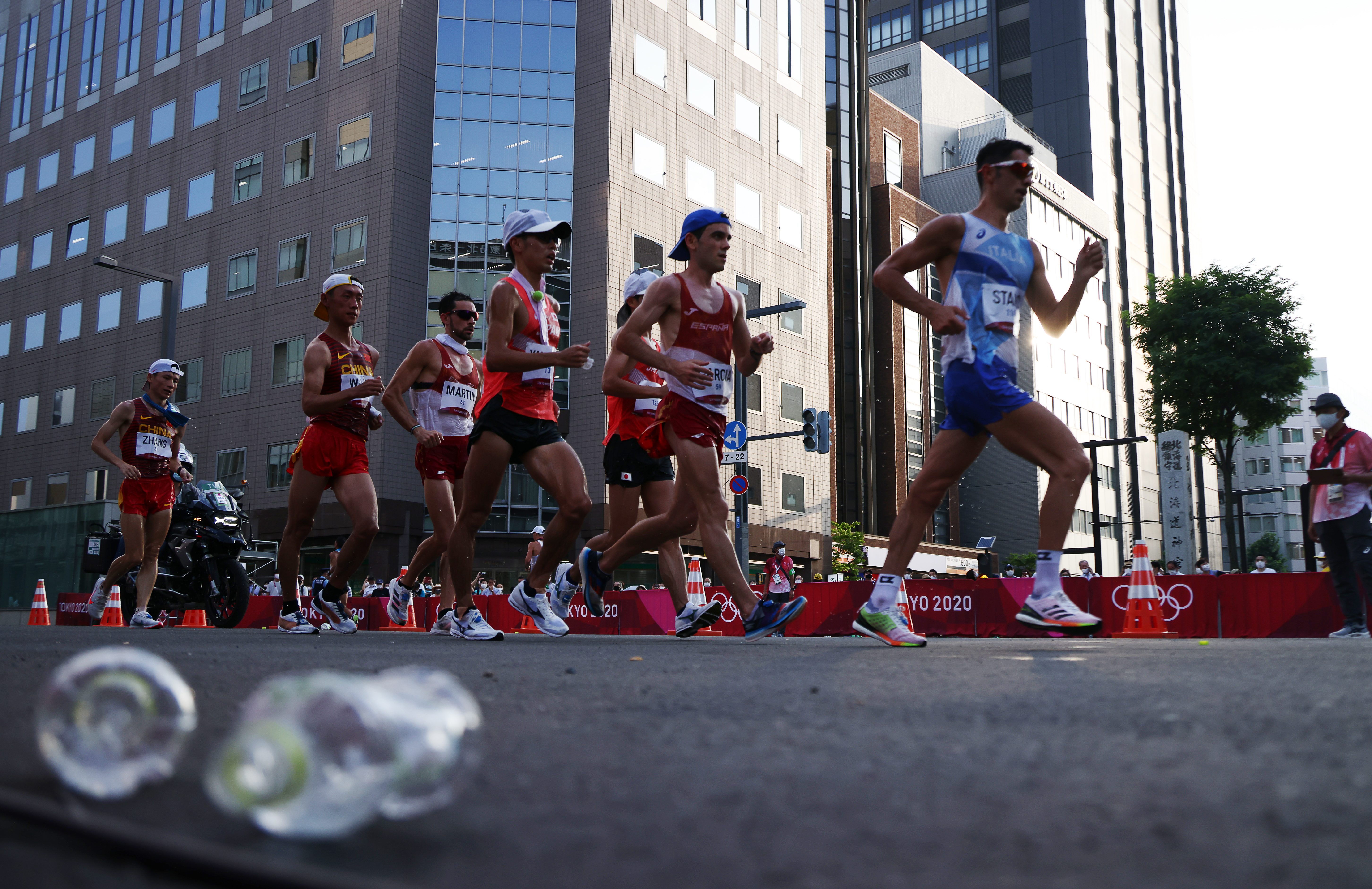 Tokyo 2020 Olympics - Athletics - Men's 20km Walk - Sapporo Odori Park, Sapporo, Japan - August 5, 2021. General view of athletes in action with Massimo Stano of Italy ahead REUTERS/Kim Hong-Ji