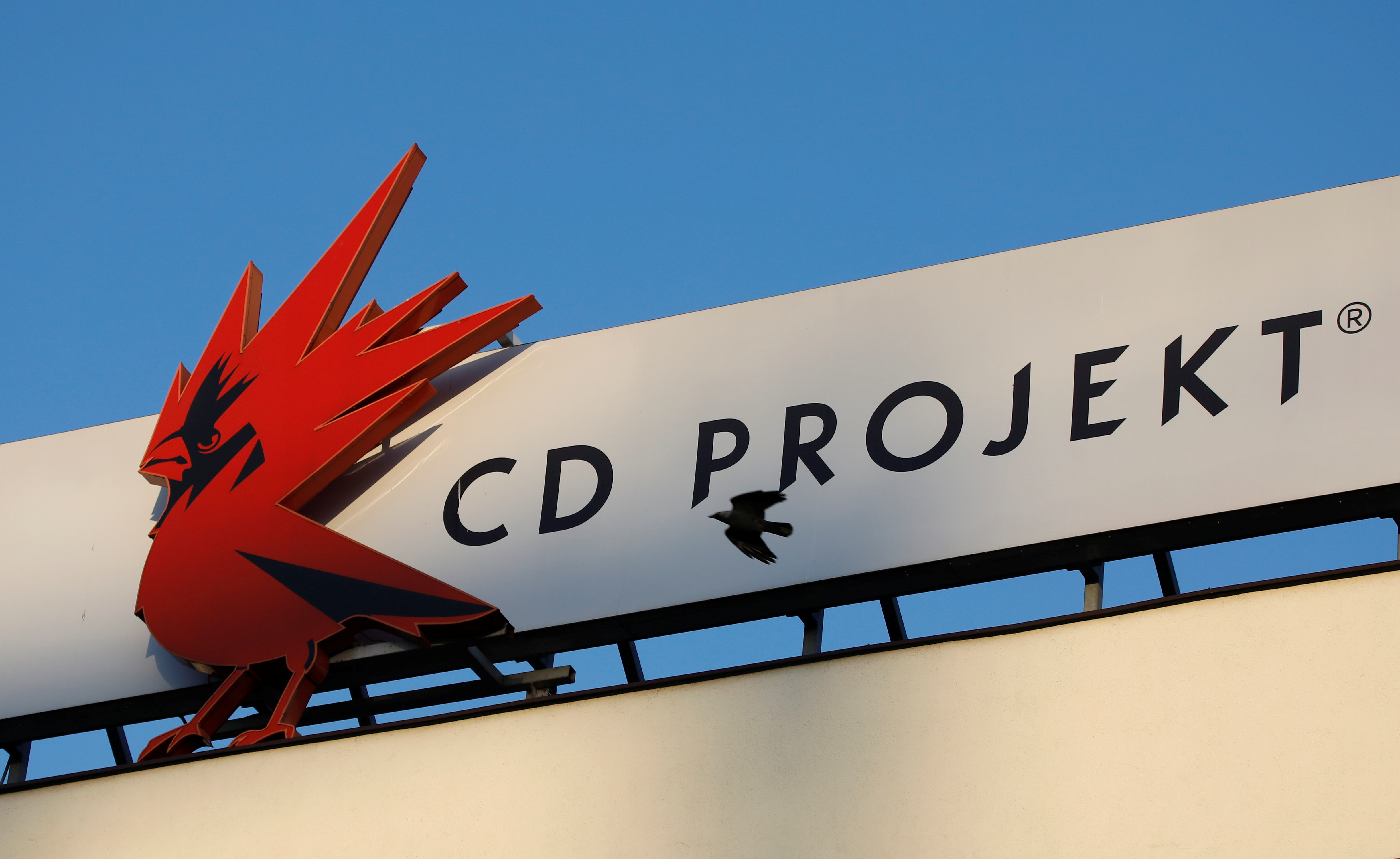 A bird flies in front of the Cd Projekt logo at its headquarters in Warsaw, Poland January 21, 2020. REUTERS/Kacper Pempel