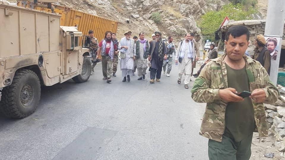 Anti-Taliban commanders walk on a road in Panjshir Valley, Afghanistan August 23, 2021. Aamaj News Agency via REUTERS