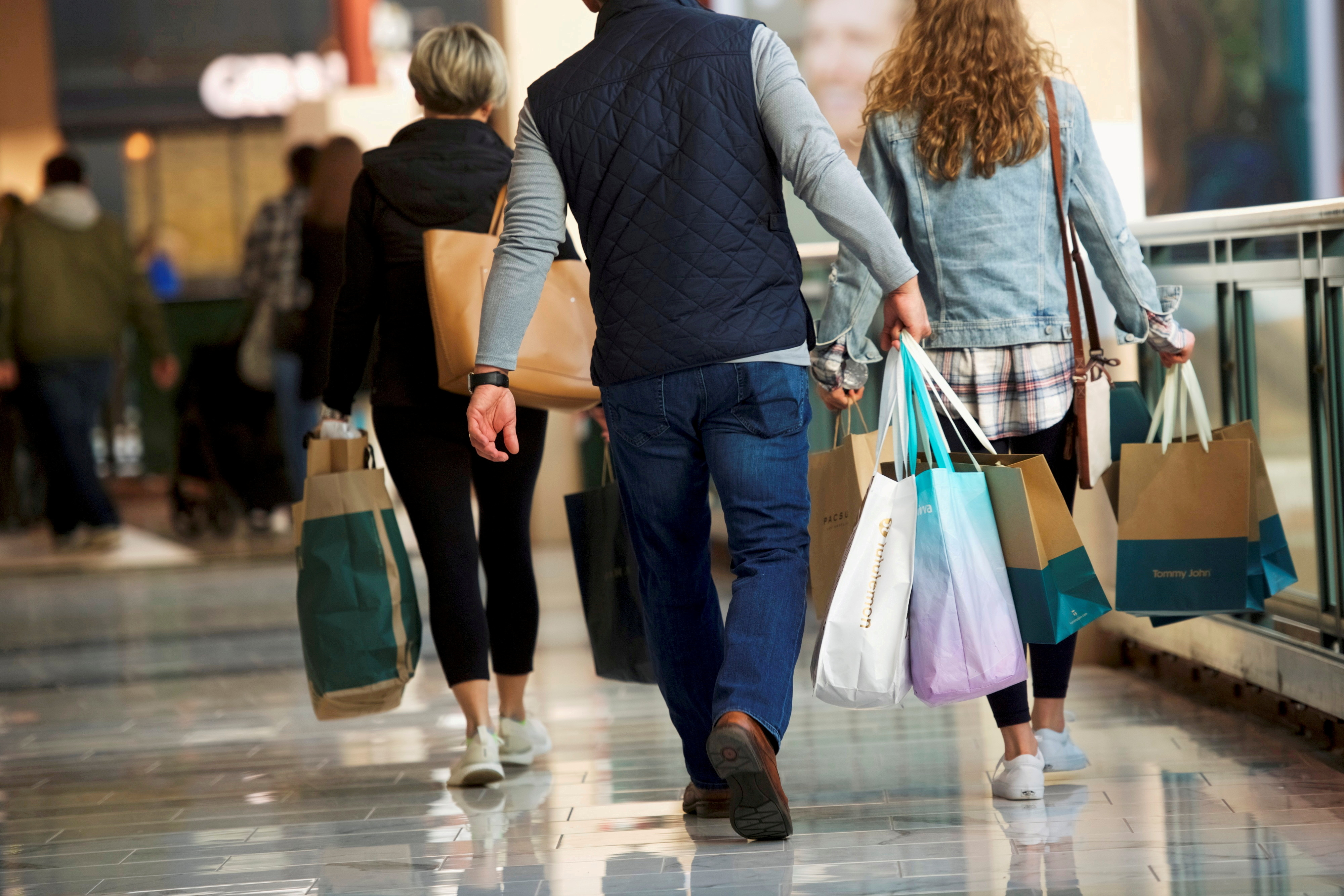 Shoppers carry bags of purchased merchandise at the King of Prussia Mall, United States' largest retail shopping space, in King of Prussia, Pennsylvania, U.S., December 8, 2018.  REUTERS/Mark Makela/File Photo/File Photo