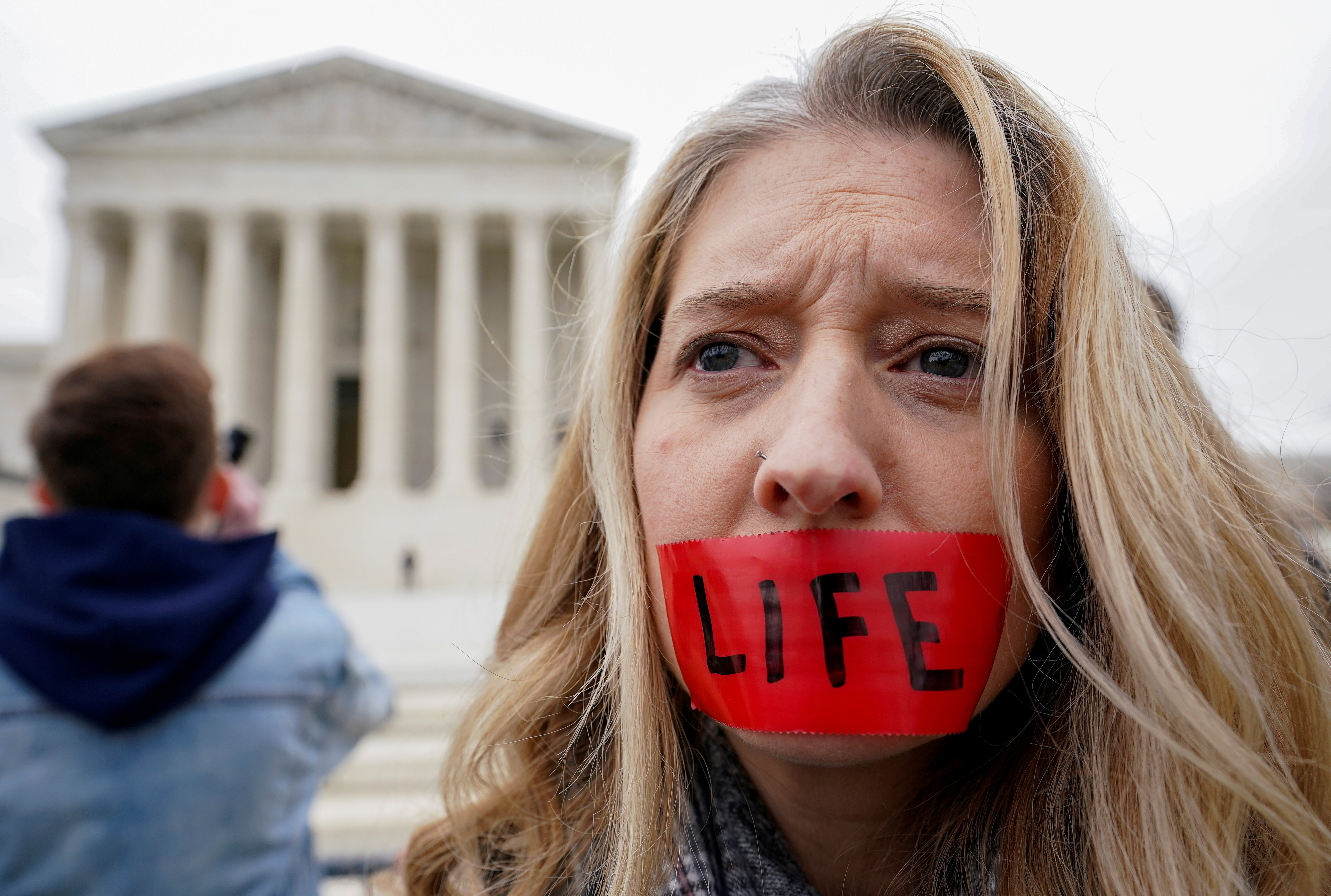 An anti-abortion activist rallies outside the U.S. Supreme Court during the the 47th annual March for Life in Washington, U.S., January 24, 2020. REUTERS/Kevin Lamarque