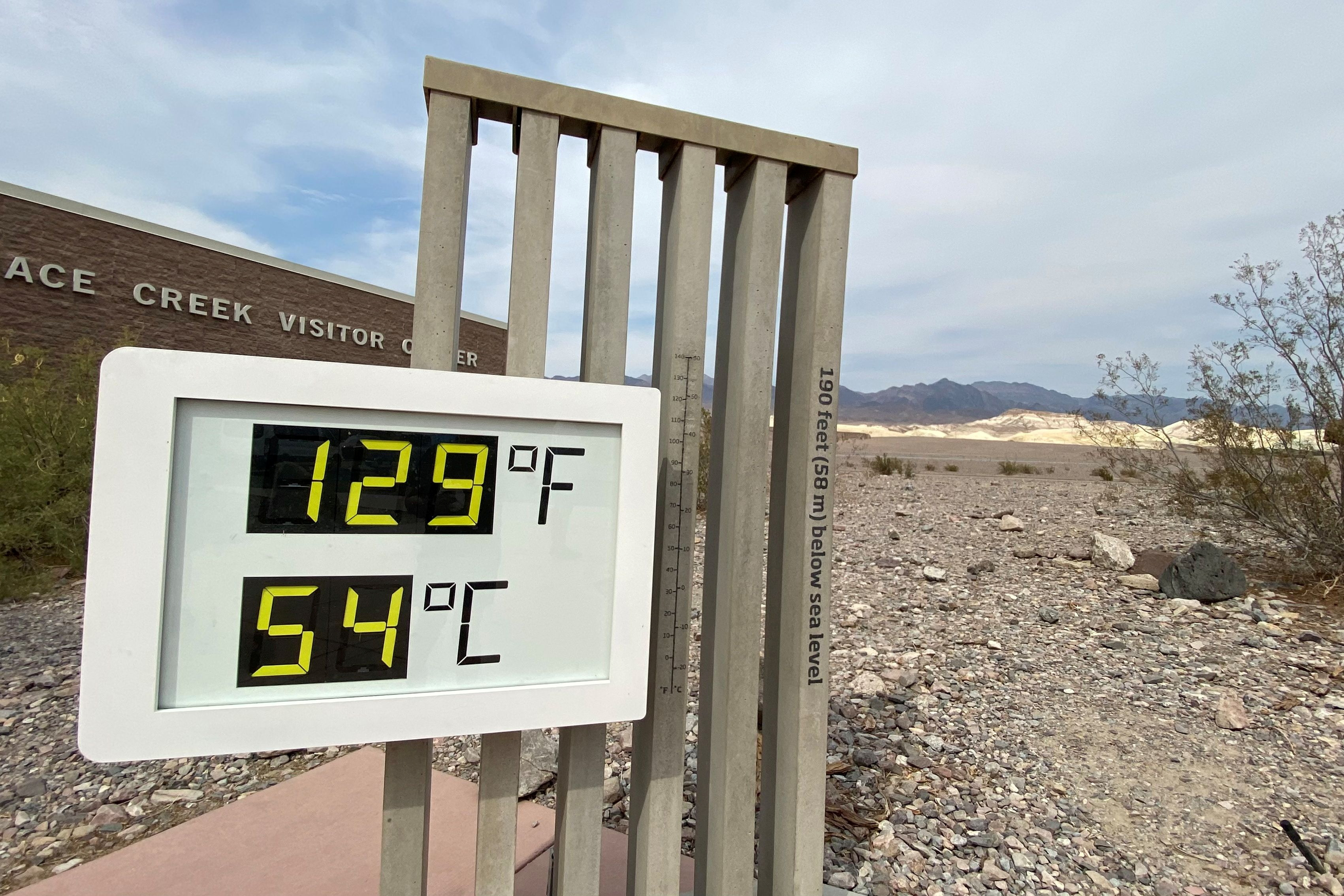 The thermometer at the Furnace Creek Visitor Center at Death Valley National Park shows temperatures reading 129 degrees Fahrenheit (53.8 C) in Death Valley, California, U.S. June 16, 2021. REUTERS/Norma Galeana/File Photo