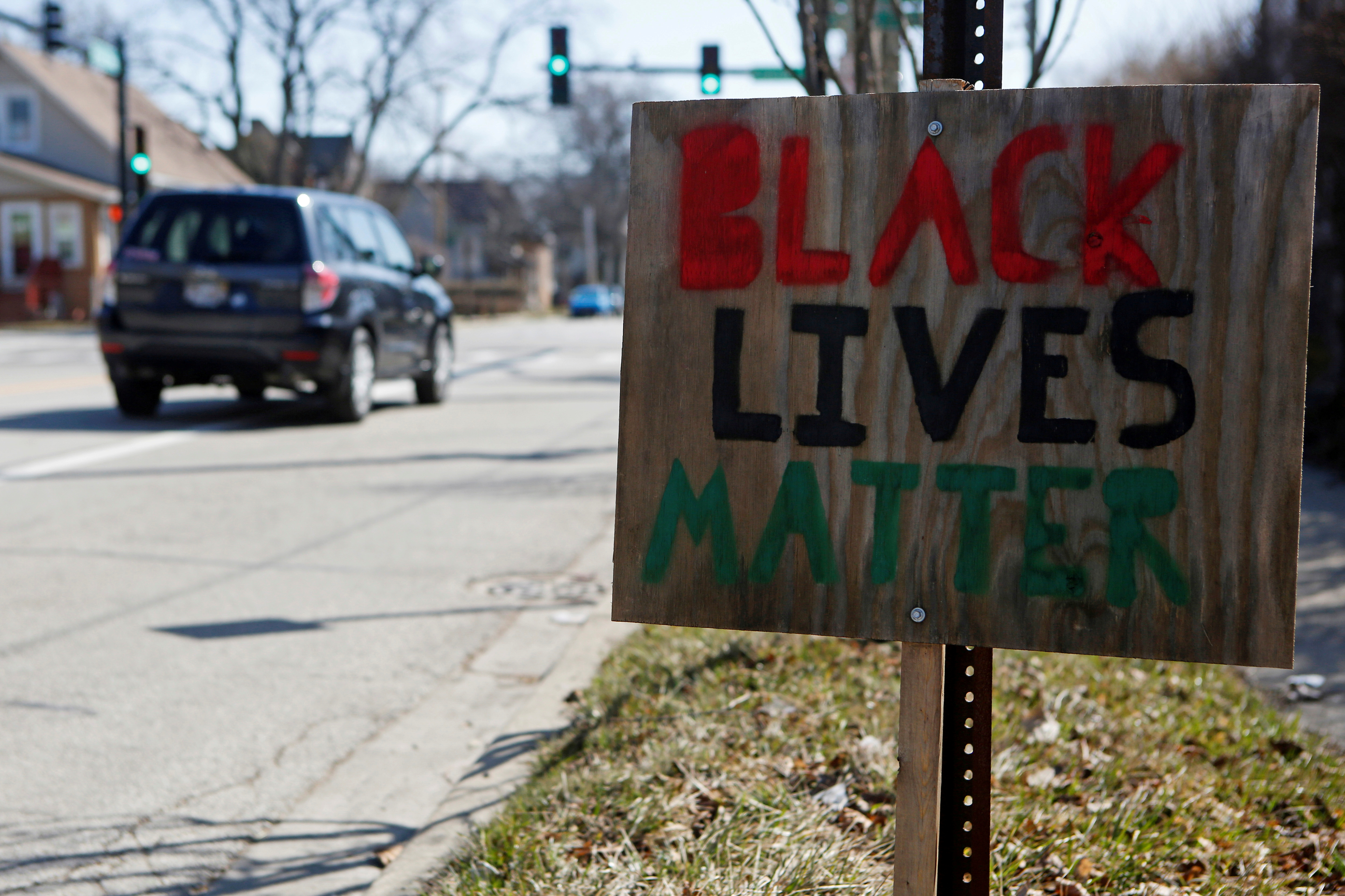A Black Lives Matter sign is seen near the corner of Emerson Street and Dodge Avenue in Evanston, Illinois, U.S., March 19, 2021. REUTERS/Eileen T. Meslar/File Photo