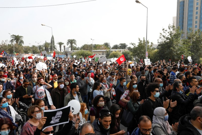 Demonstrators protest to mark the anniversary of a prominent activist's death and against allegations of police abuse, in Tunis, Tunisia February 6, 2021. REUTERS/Zoubeir Souissi