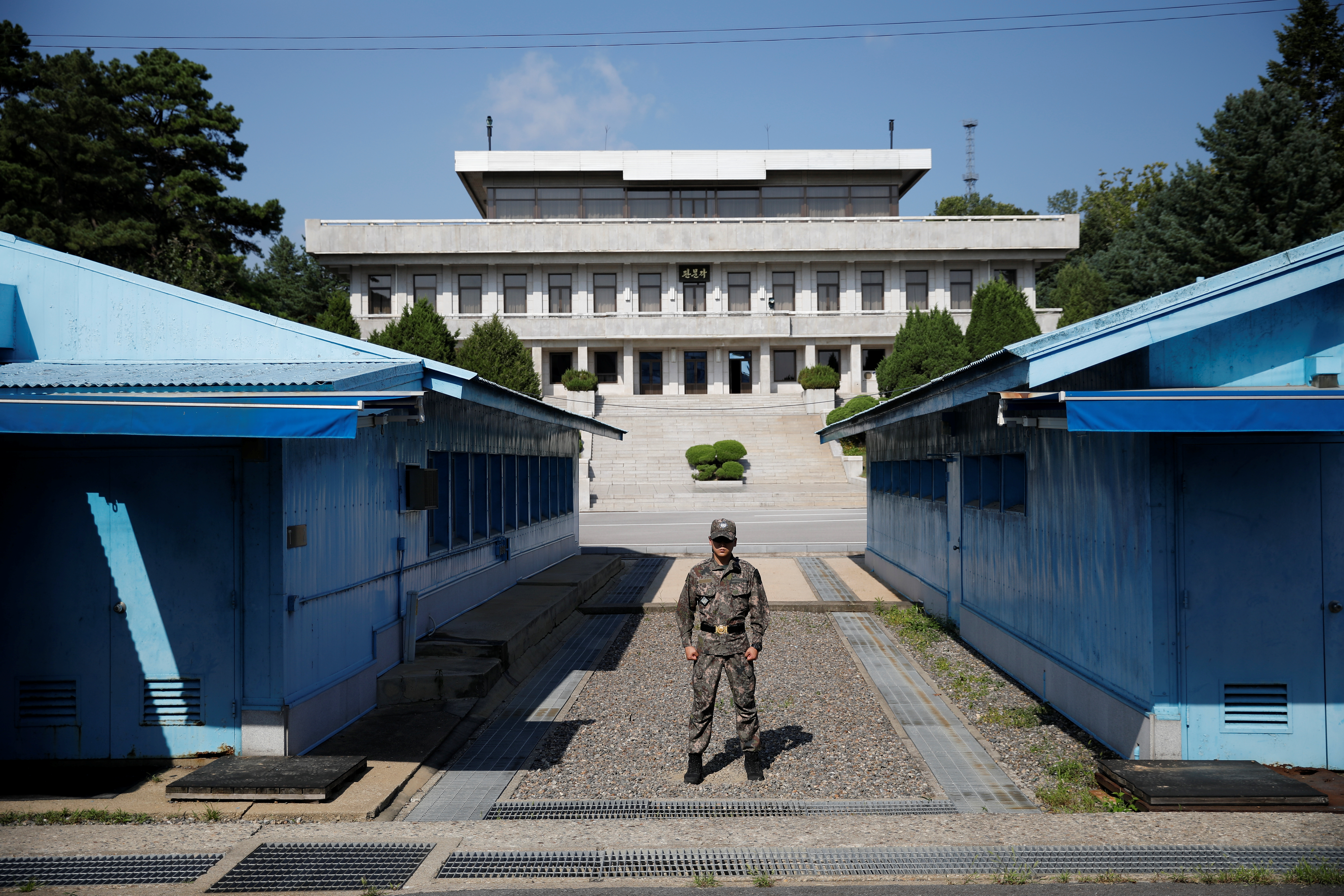 A South Korean soldier stands guard in the truce village of Panmunjom inside the demilitarized zone (DMZ) separating the two Koreas, South Korea, August 28, 2019.    REUTERS/Kim Hong-Ji/Pool