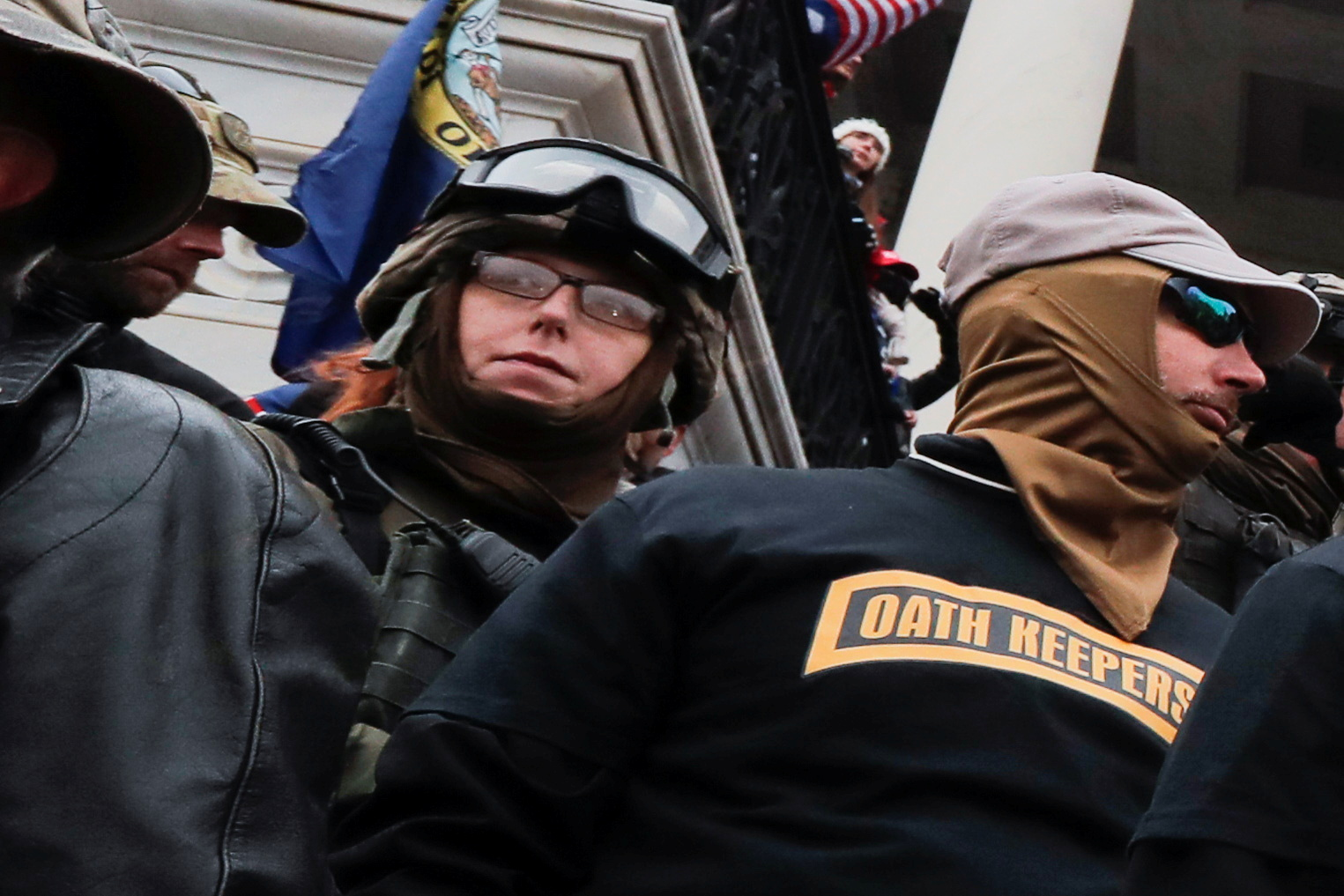 Members of the Oath Keepers militia group stand among supporters of former President Trump on the east front steps of the U.S. Capitol in Washington, January 6, 2021. REUTERS/Jim Bourg
