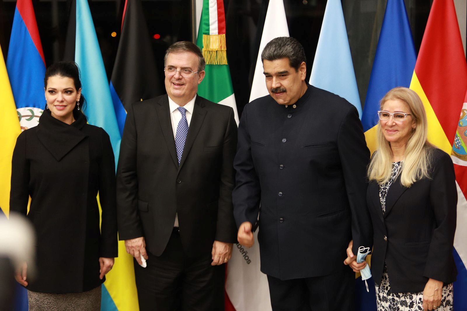 Mexico's Foreign Relations Minister Marcelo Ebrard poses for a photo with Venezuelan President Nicolas Maduro, flanked by National Assembly member and first lady Cilia Flores and his wife Rosalinda Bueso, at the Benito Juarez International airport ahead of the summit of the Community of Latin American and Caribbean States (CELAC), in Mexico City, Mexico September 17, 2021. Mexico's Foreign Relations Ministry/Handout via REUTERS