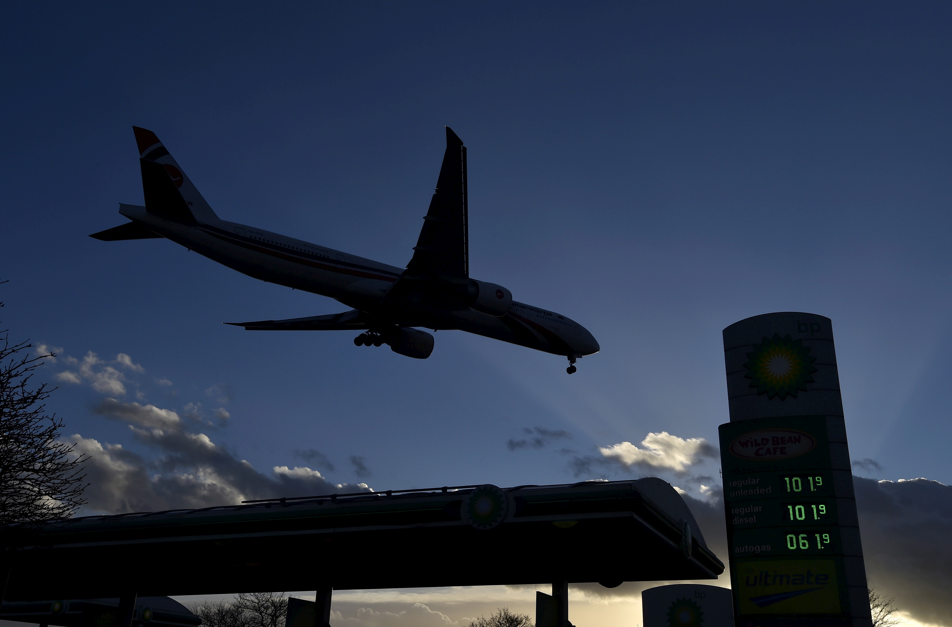 BP gas station signage is seen as a passenger plane makes its final landing approach to Heathrow Airport in west London, Britain January 30, 2016. REUTERS/Toby Melville/File Photo
