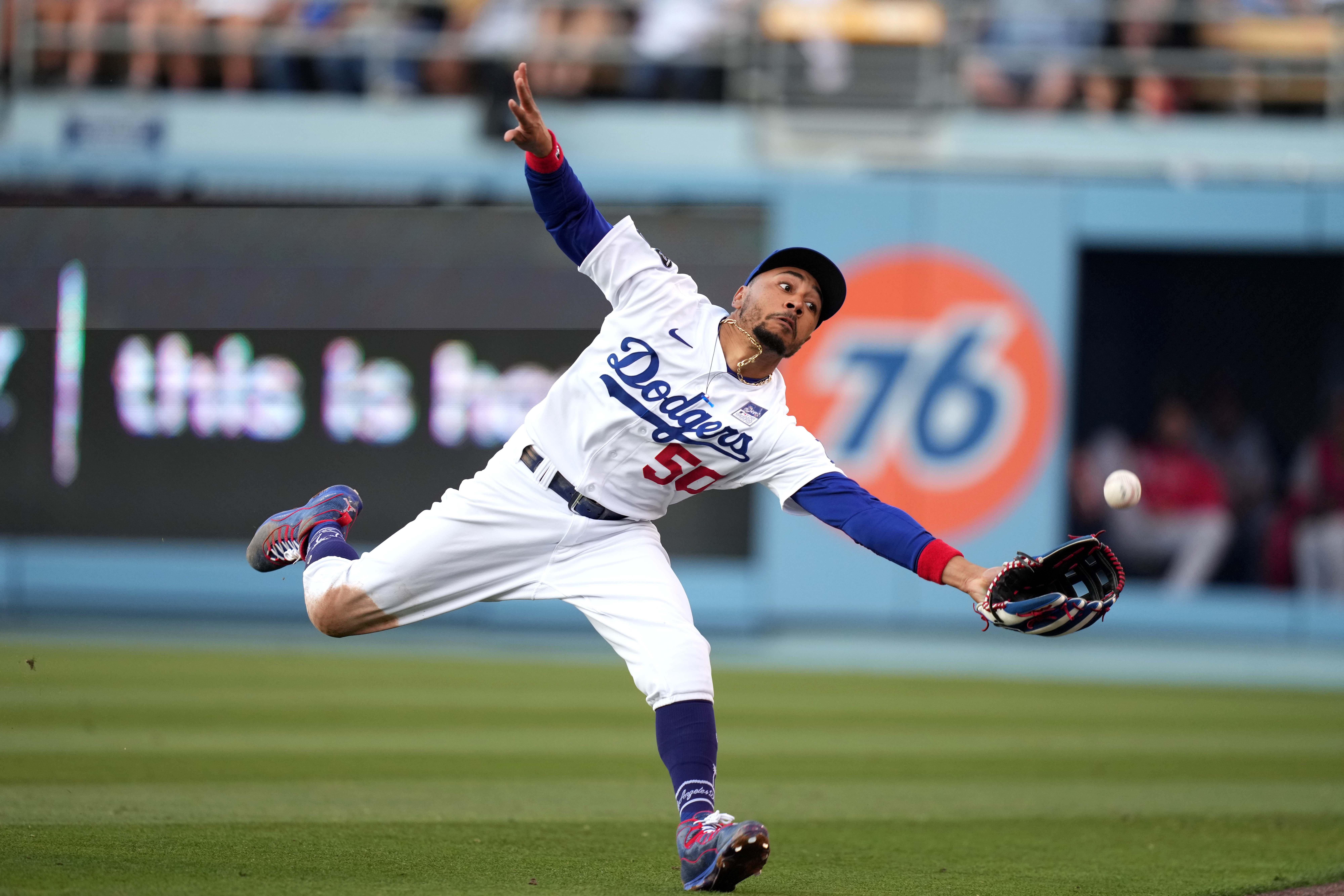Jun 2, 2021; Los Angeles, California, USA; Los Angeles Dodgers right fielder Mookie Betts (50) attempts to catch a fly ball during the third inning against the St. Louis Cardinals at Dodger Stadium. Mandatory Credit: Kirby Lee-USA TODAY Sports