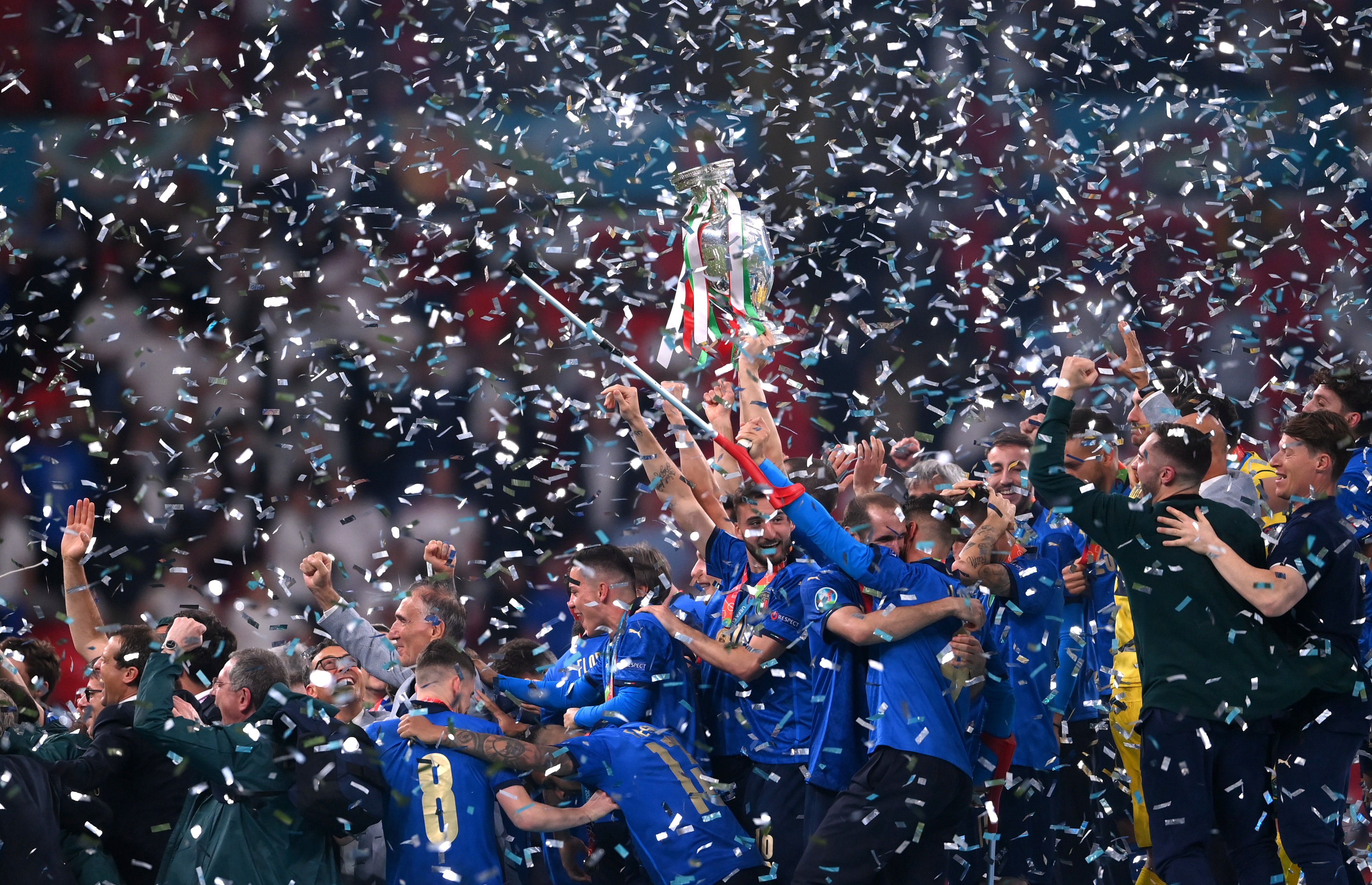 Soccer Football - Euro 2020 - Final - Italy v England - Wembley Stadium, London, Britain - July 11, 2021 Italy players celebrate with the trophy after winning Euro 2020 Pool via REUTERS/Laurence Griffiths