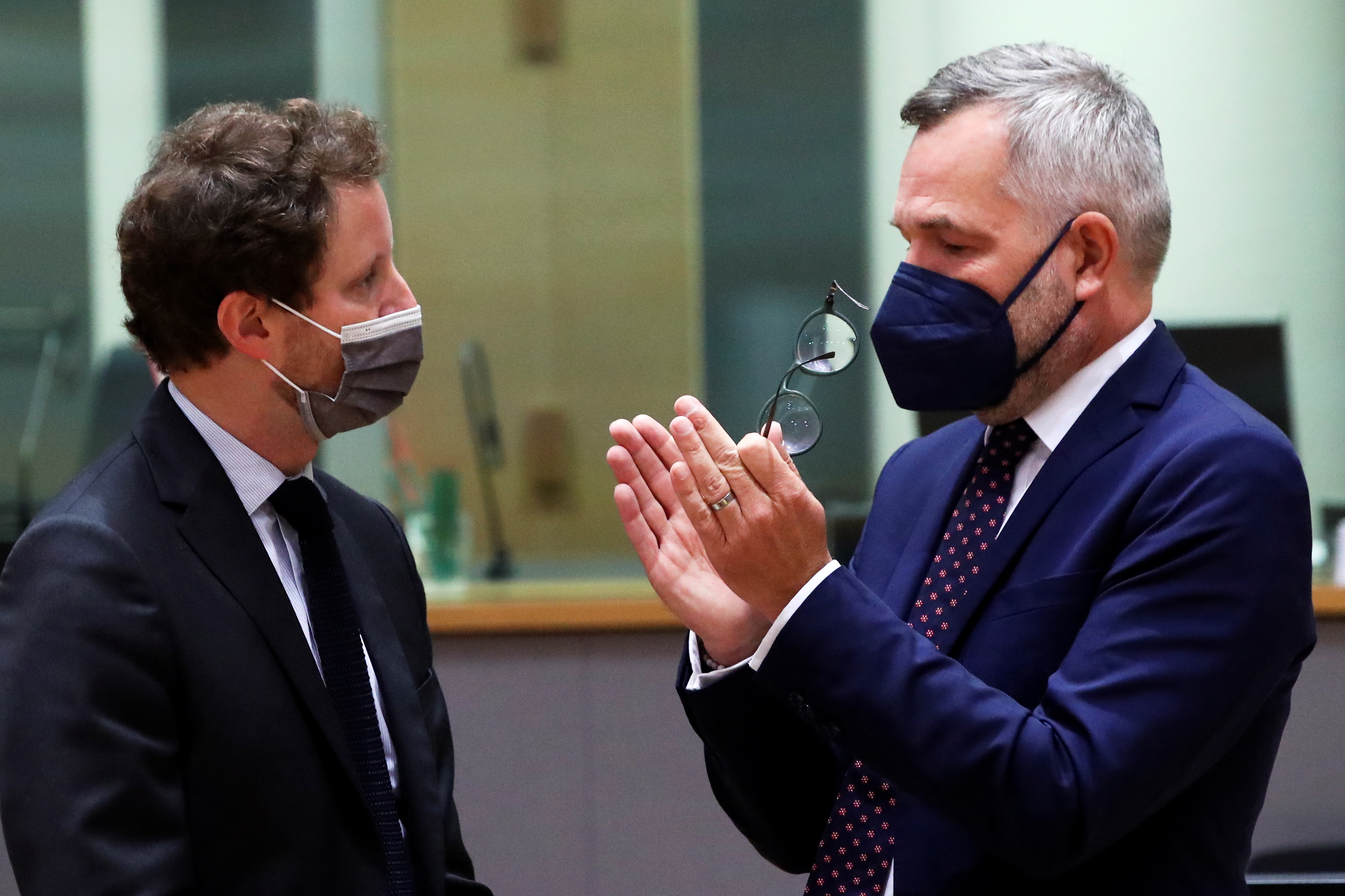 French minister for European affairs Clement Beaun and his German counterpart Michael Roth meet during an EU general affairs council in Brussels, Belgium September 21, 2021. REUTERS/Yves Herman