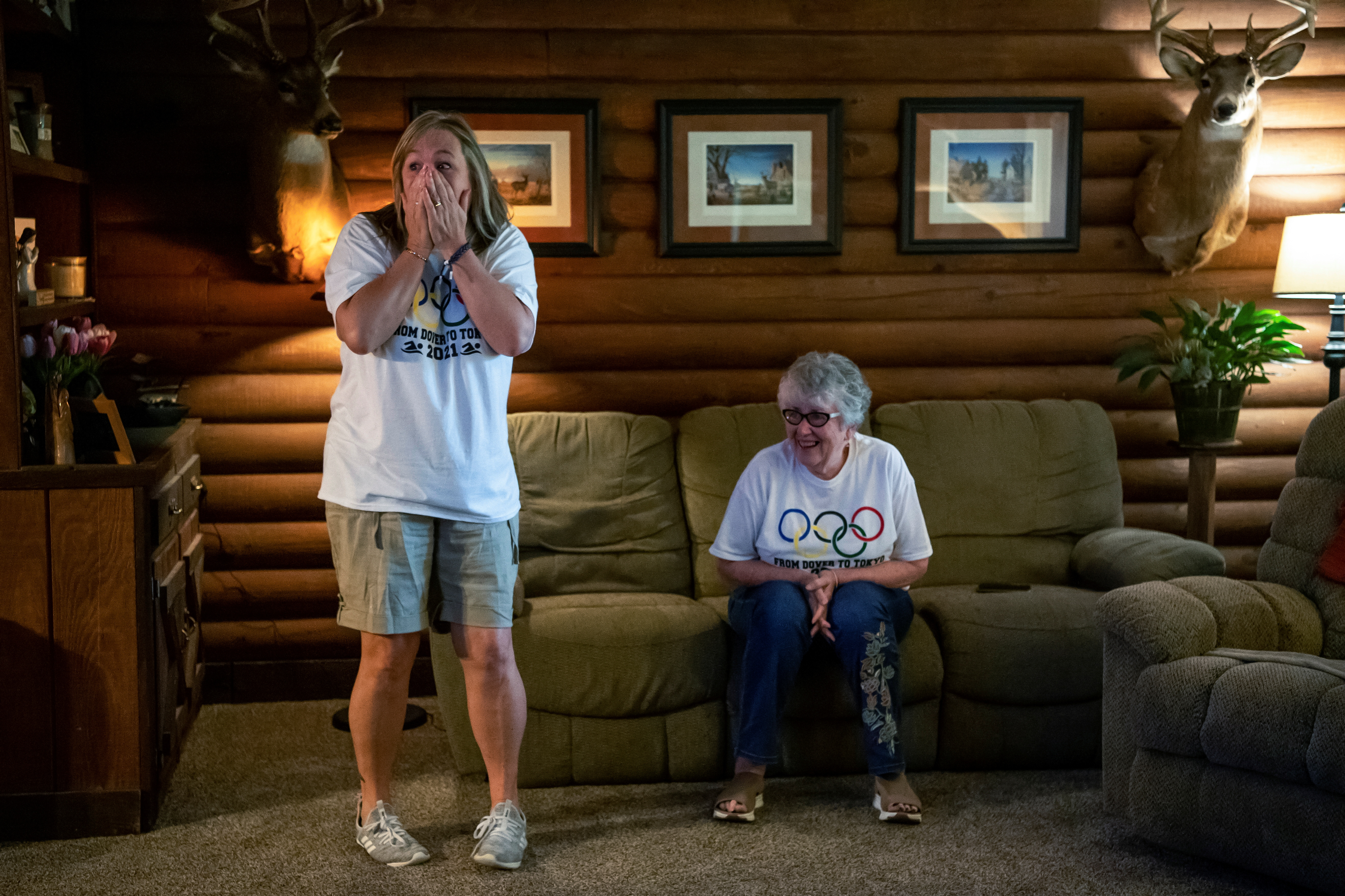 Edie Armstrong reacts when she hears that her son, U.S. swimmer Hunter Armstrong, will be moving on after just making it through the men's 100m backstroke preliminary race during the 2021 Olympic Games, in Dover, Ohio, U.S., July 25, 2021.