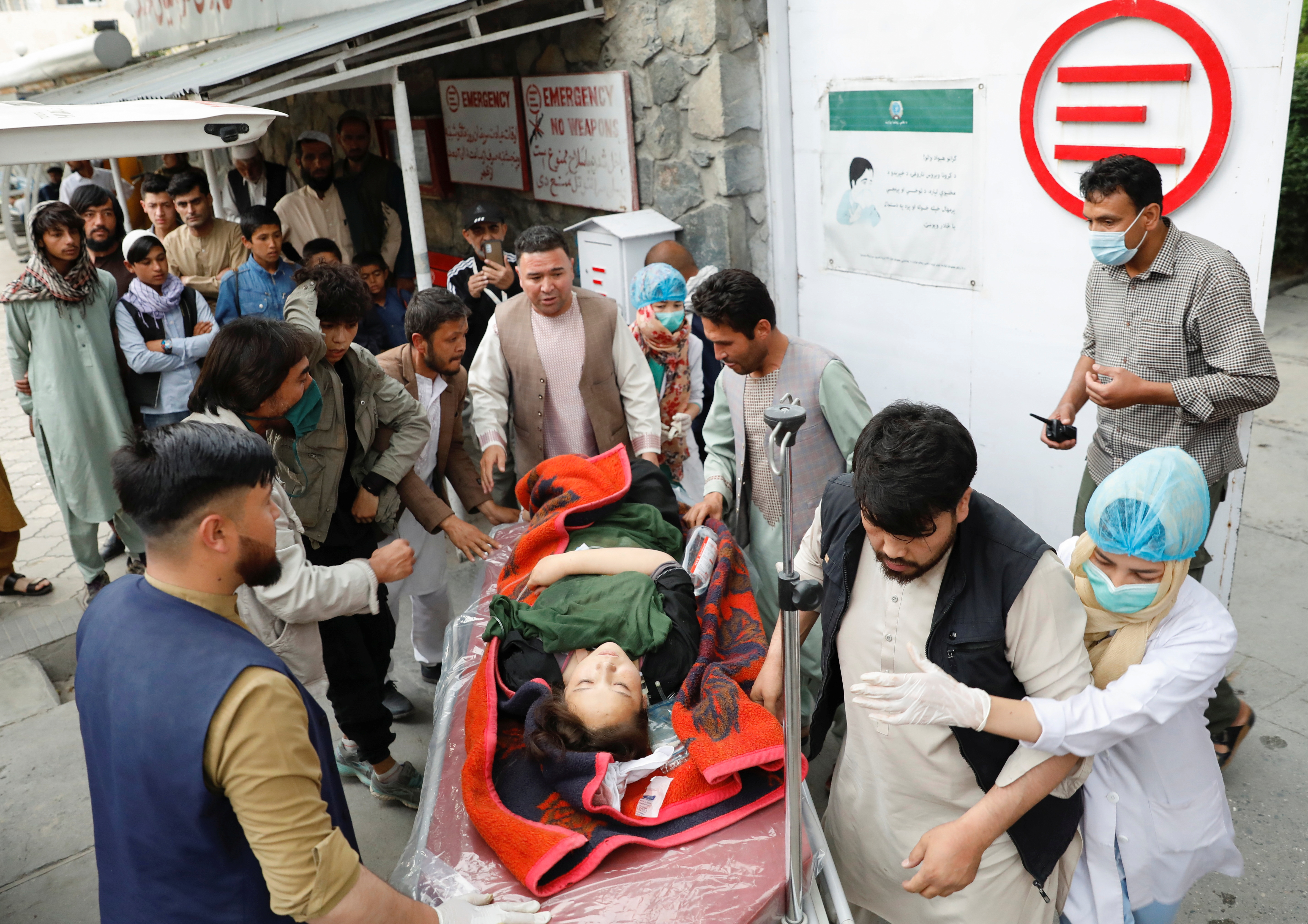 An injured woman is transported  to a hospital after a blast in Kabul, Afghanistan May 8, 2021. REUTERS/Mohammad Ismail