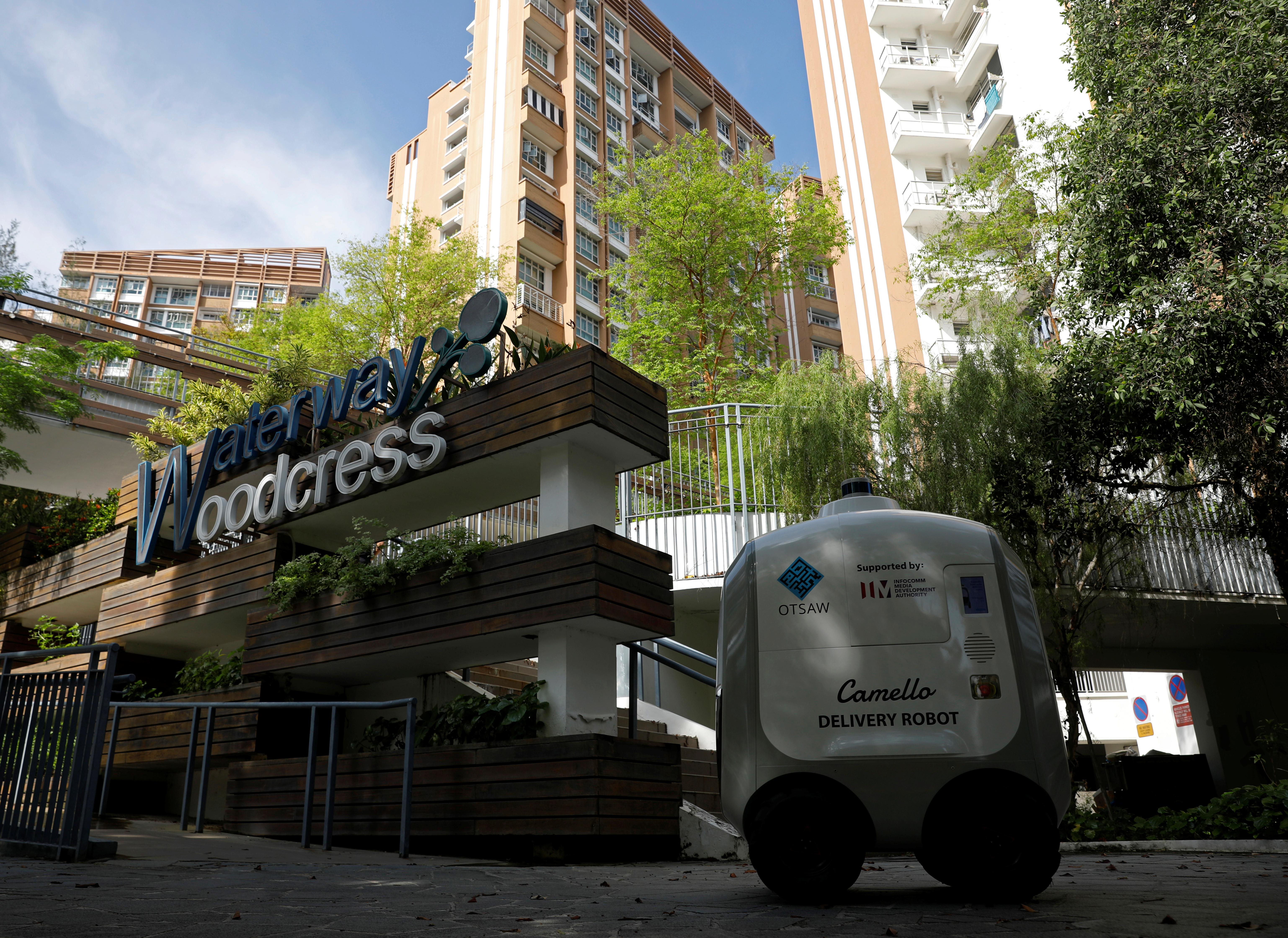 Camello, an autonomous grocery delivery robot, makes its way during a delivery in Singapore April 6, 2021. REUTERS/Edgar Su