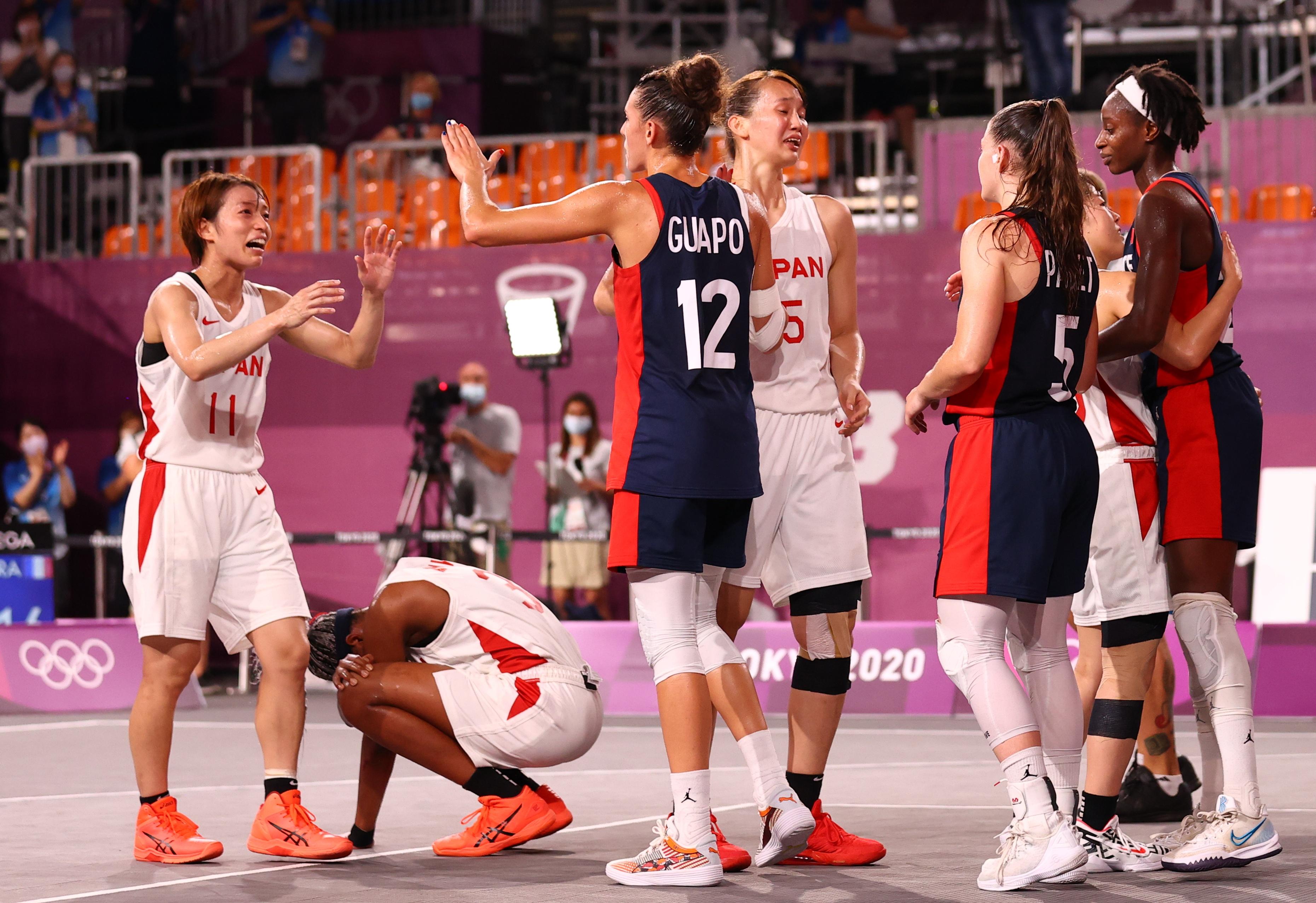 Tokyo 2020 Olympics - Basketball 3x3 - Women - Quarterfinal - Japan v France - Aomi Urban Sports Park, Tokyo Japan - July 27, 2021. Players of Japan greet players of France after the match. REUTERS/Andrew Boyers