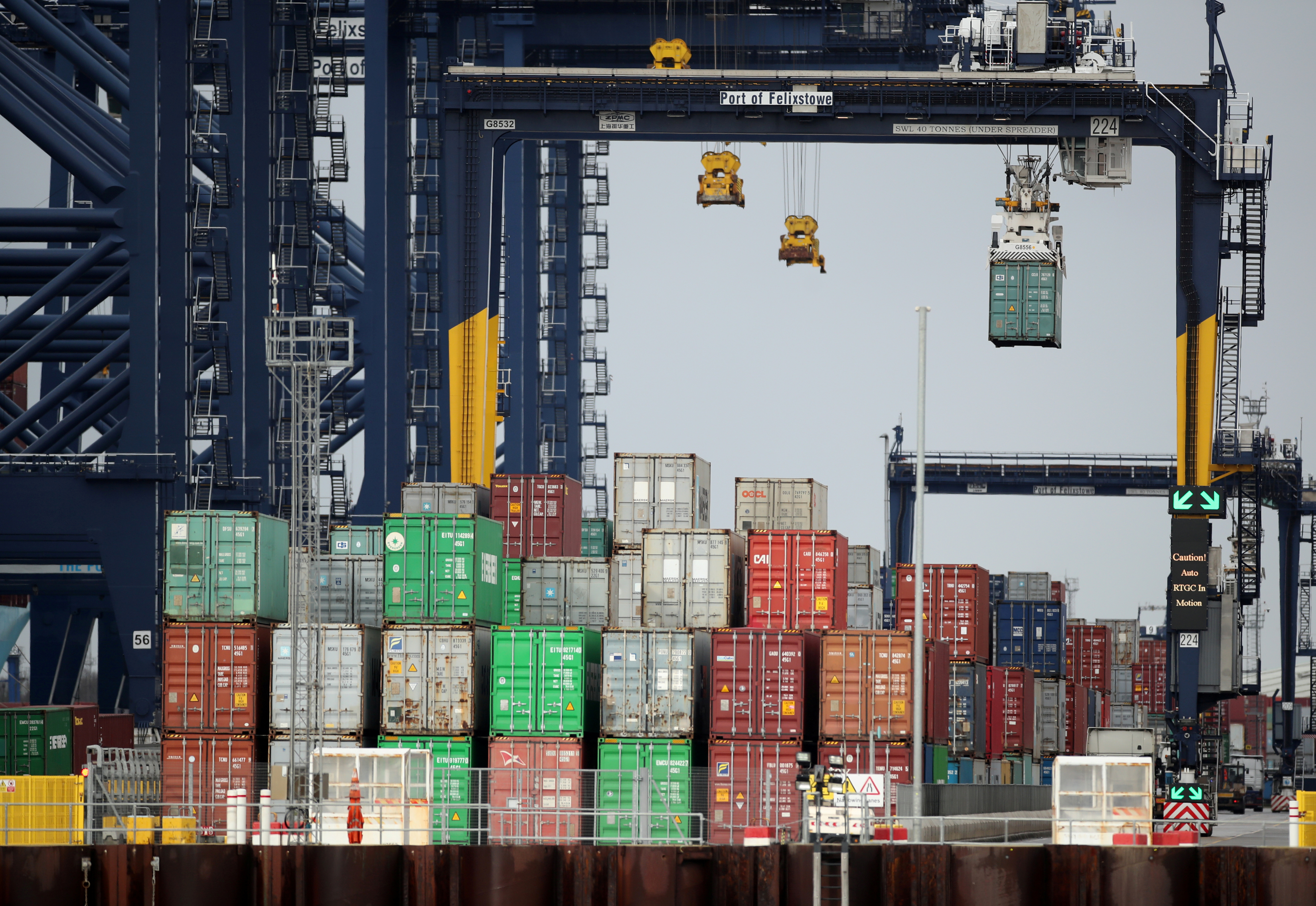 Containers are stacked at the Port of Felixstowe, Britain, January 28, 2021.  REUTERS/Peter Cziborra/File Photo