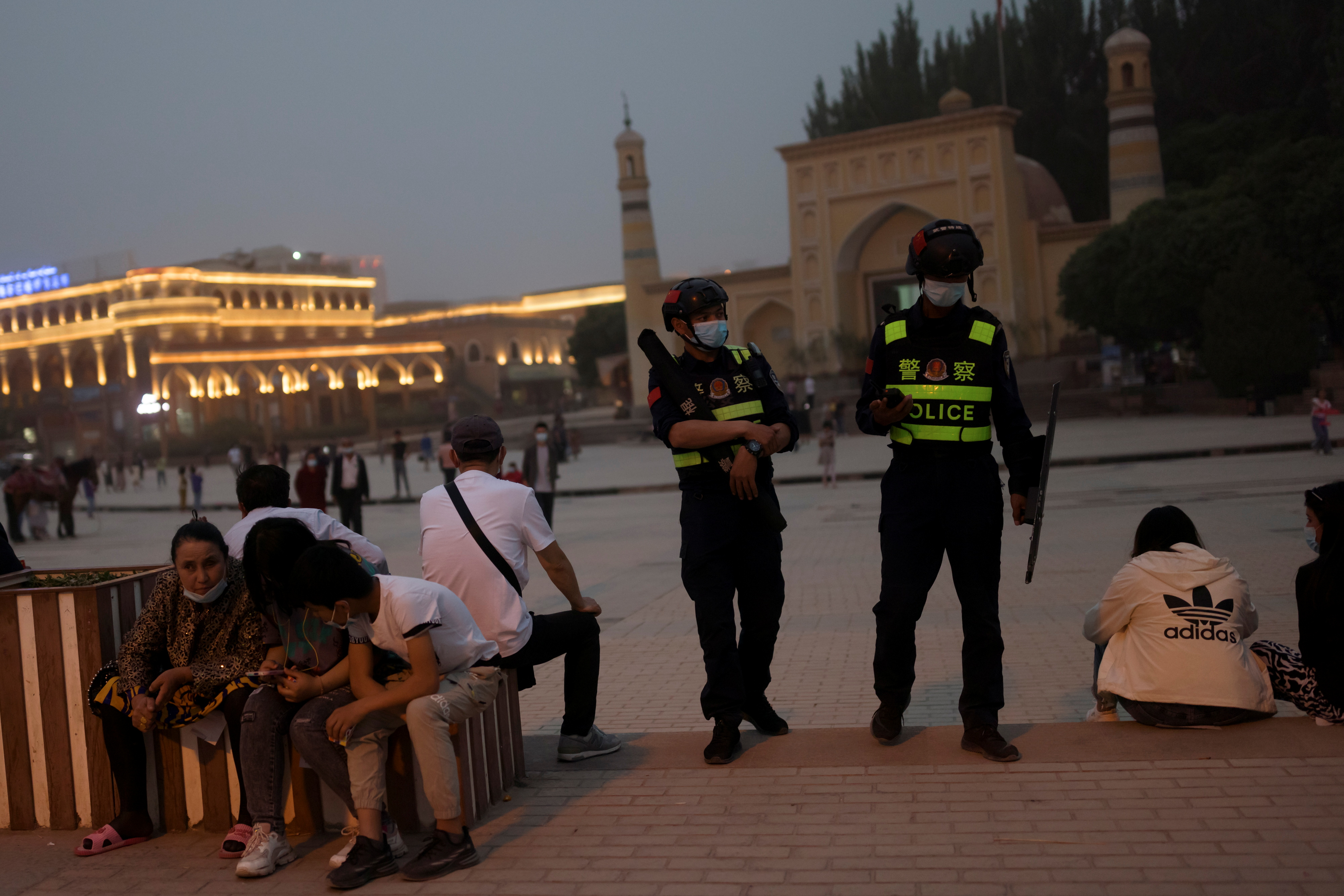 Police officers patrol the square in front of Id Kah Mosque in Kashgar, Xinjiang Uyghur Autonomous Region, China, May 3, 2021. REUTERS/Thomas Peter