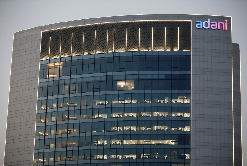 The logo of the Adani Group is seen on the facade of one of its buildings on the outskirts of Ahmedabad, India, April 13, 2021. REUTERS/Amit Dave/File photo