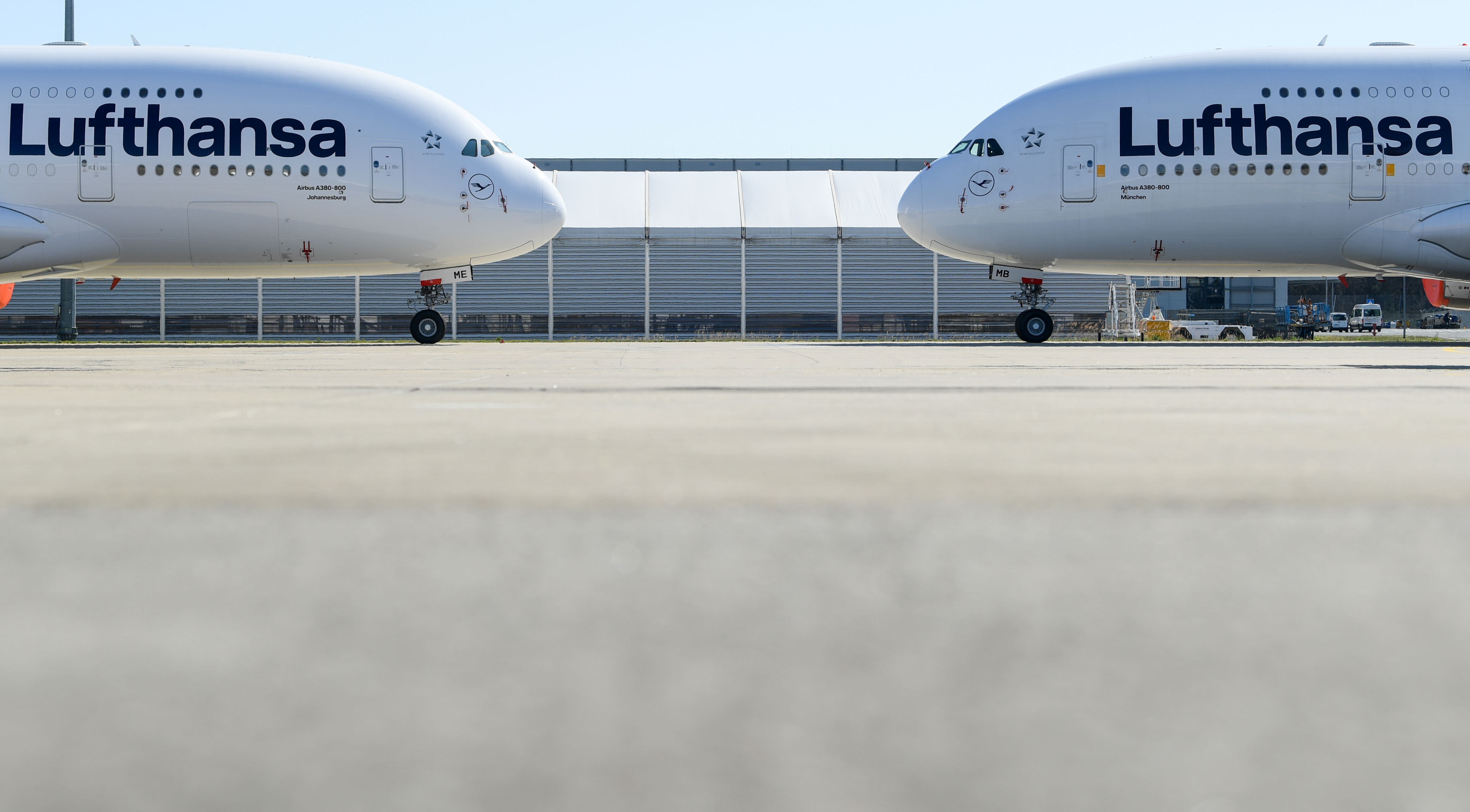 Two Lufthansa planes are seen in Frankfurt, Germany, March 23, 2020.