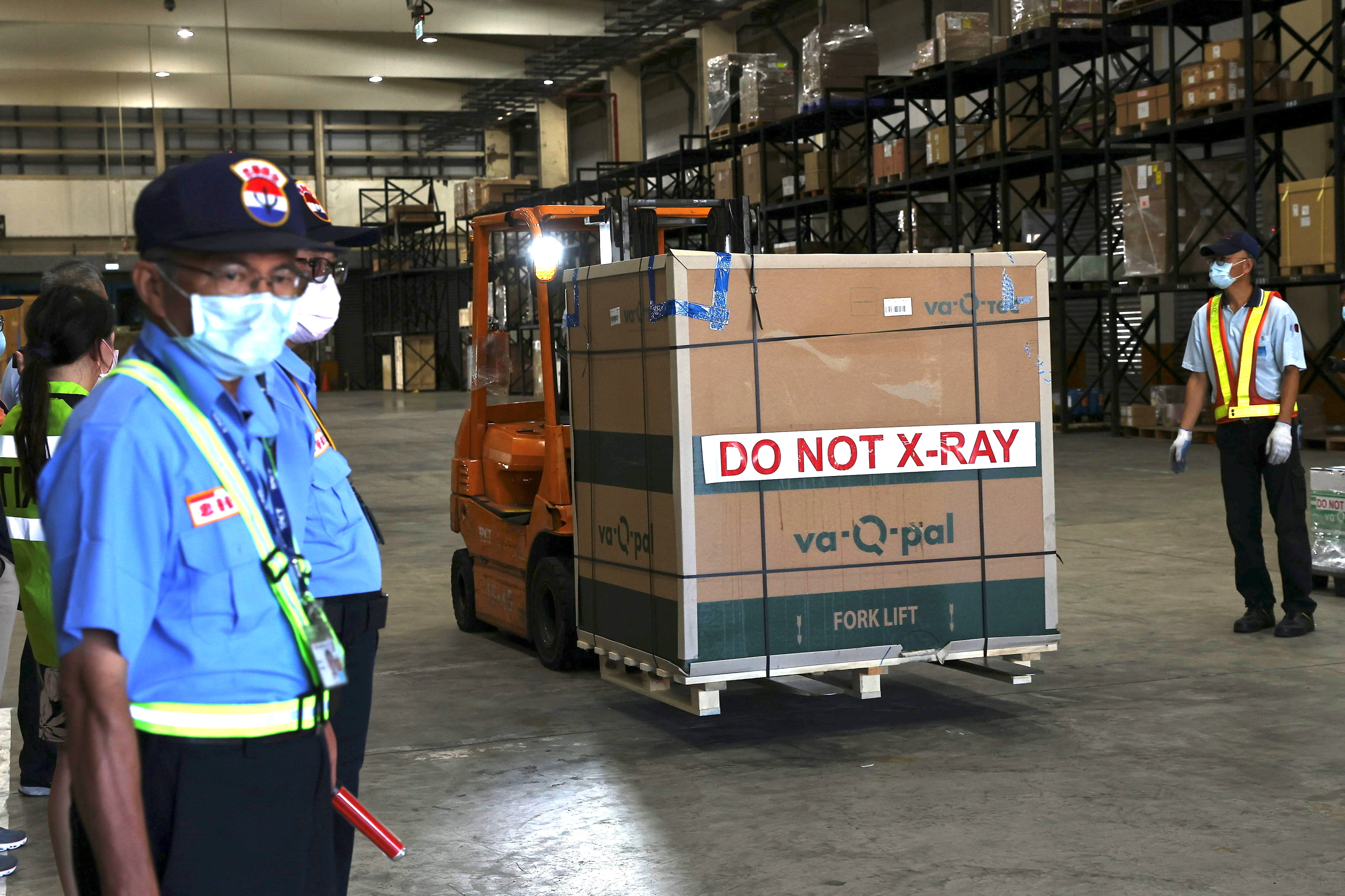 A forklift is used to transport Moderna vaccines against the coronavirus disease (COVID-19) at Taiwan Air cargo Terminal in Taoyuan, Taiwan, June 18, 2021. REUTERS/Ann Wang