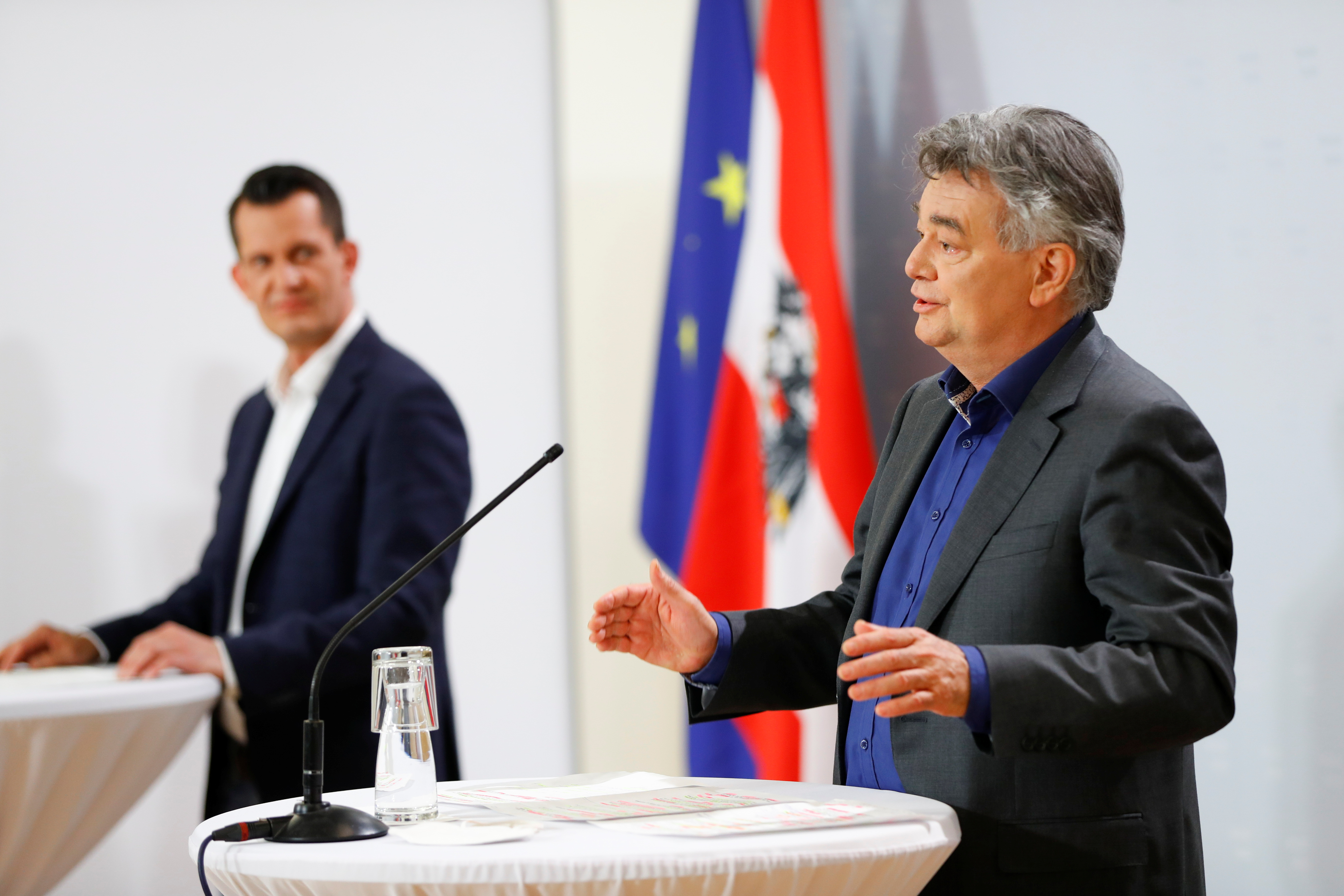 Austrian Vice Chancellor Werner Kogler and designated Health Minister Wolfgang Mueckstein attend a news conference in Vienna, Austria April 13, 2021. REUTERS/Leonhard Foeger