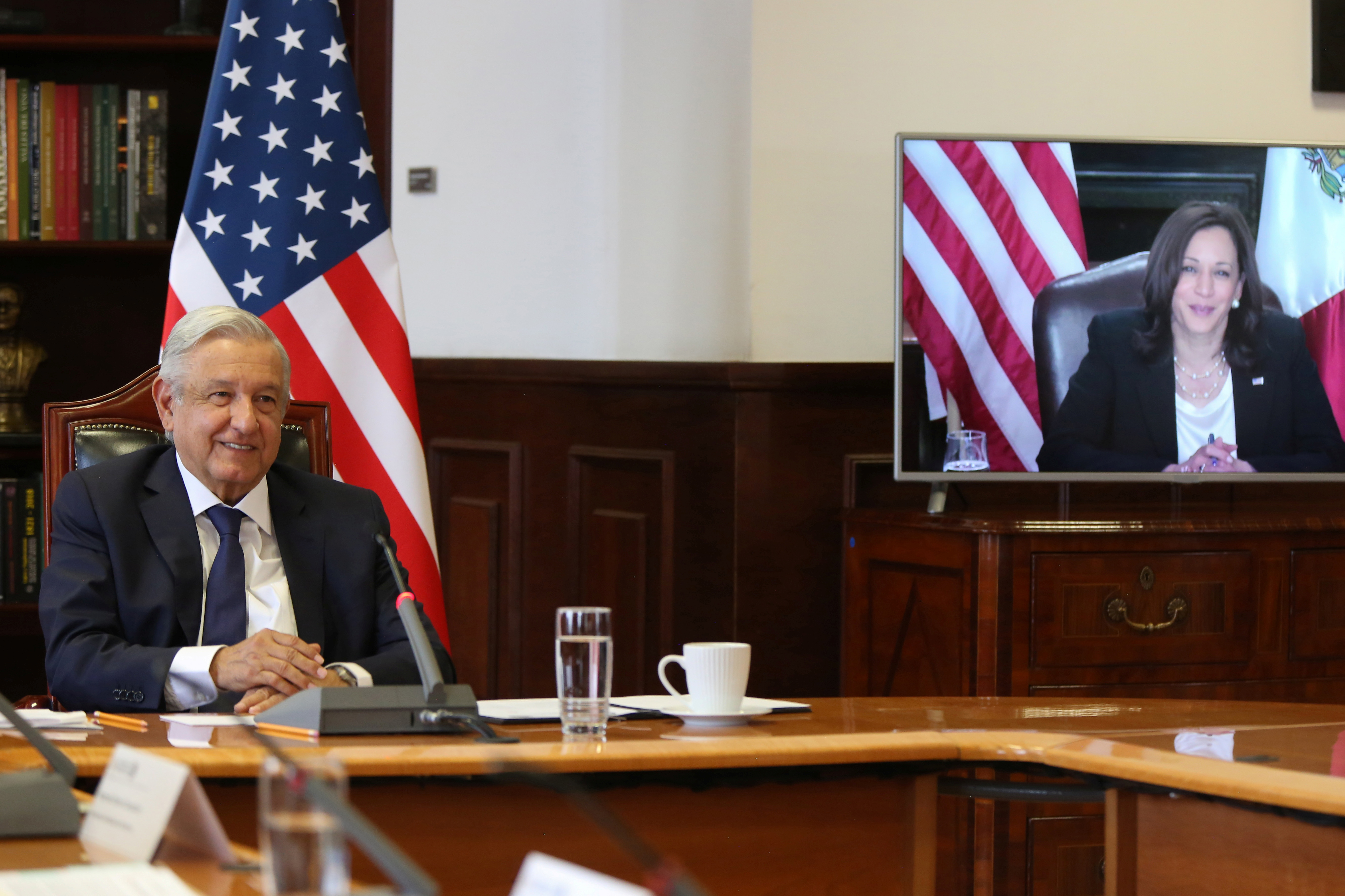 Mexican President Andres Manuel Lopez Obrador holds a virtual bilateral meeting with U.S. Vice President Kamala Harris from the National Palace in Mexico City, Mexico May 7, 2021. Mexico's Presidency/Handout via REUTERS