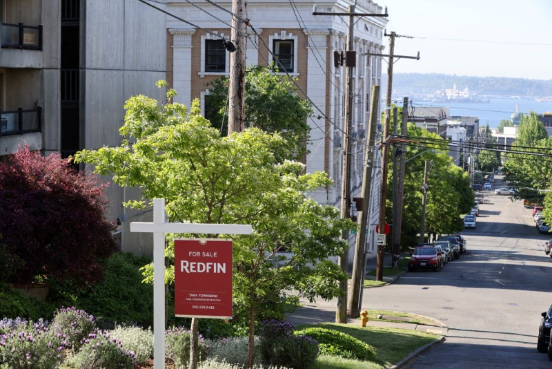 """A """"For Sale"""" sign is posted outside a residential home in the Queen Anne neighborhood of Seattle, Washington, U.S. May 14, 2021.   REUTERS/Karen Ducey"""
