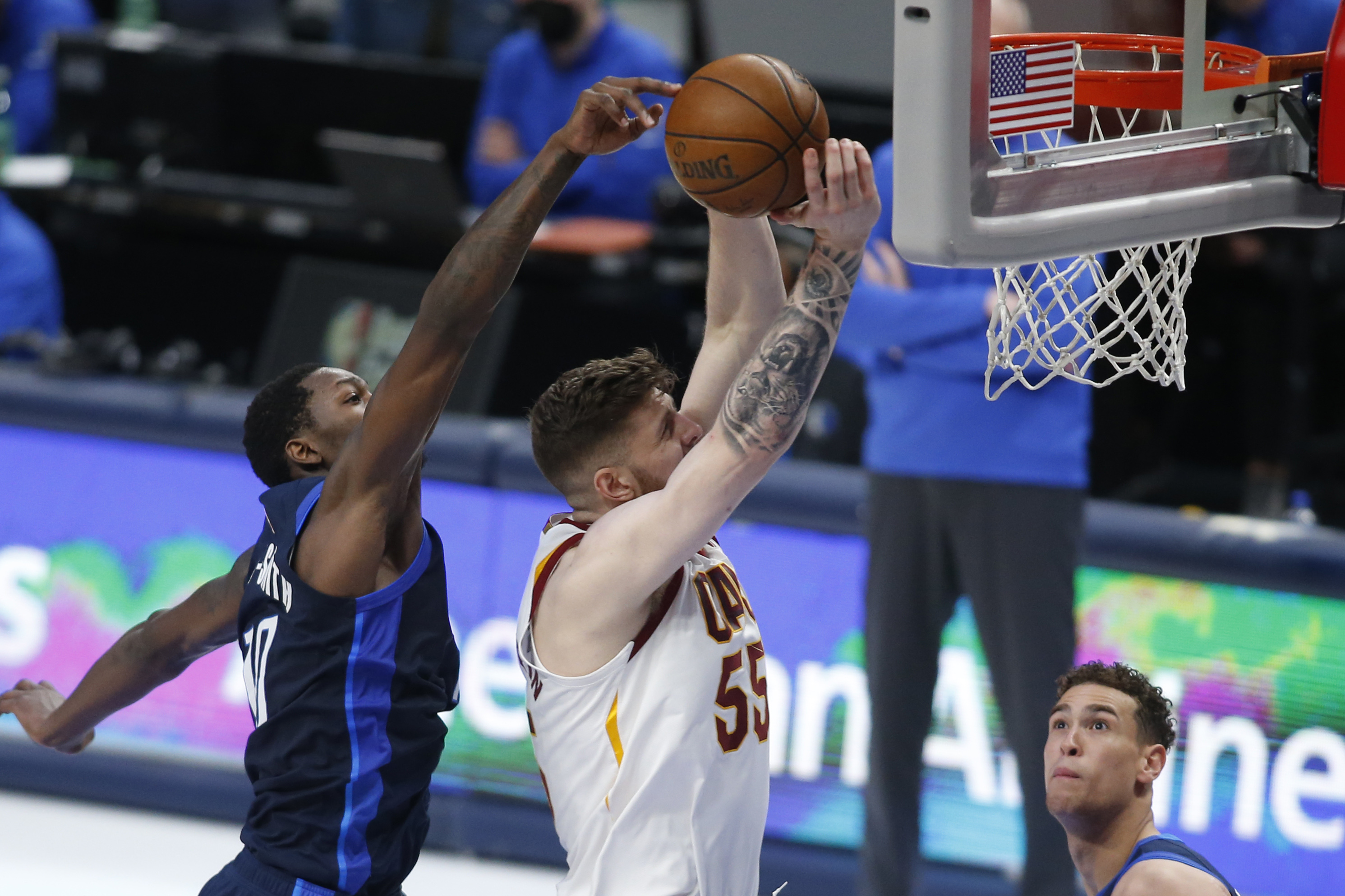 May 7, 2021; Dallas, Texas, USA; Dallas Mavericks forward Dorian Finney-Smith (10) blocks the shot of Cleveland Cavaliers center Isaiah Hartenstein (55) during the third quarter at American Airlines Center. Mandatory Credit: Tim Heitman-USA TODAY Sports