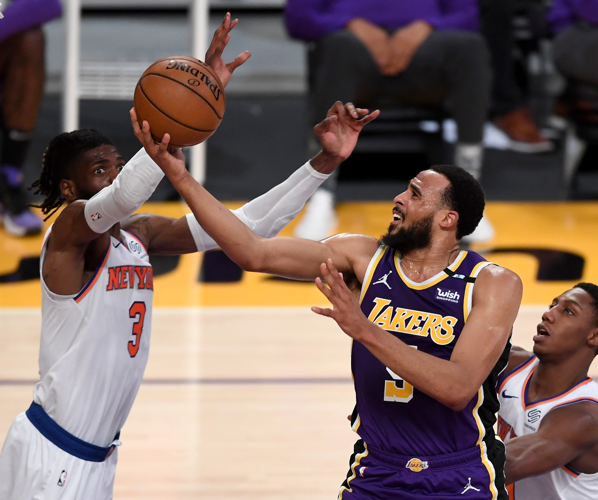 May 11, 2021; Los Angeles, California, USA;    Los Angeles Lakers guard Talen Horton-Tucker (5) is defended by New York Knicks center Nerlens Noel (3) as he goes up for a basket in the first half of the game at Staples Center. Mandatory Credit: Jayne Kamin-Oncea-USA TODAY Sports
