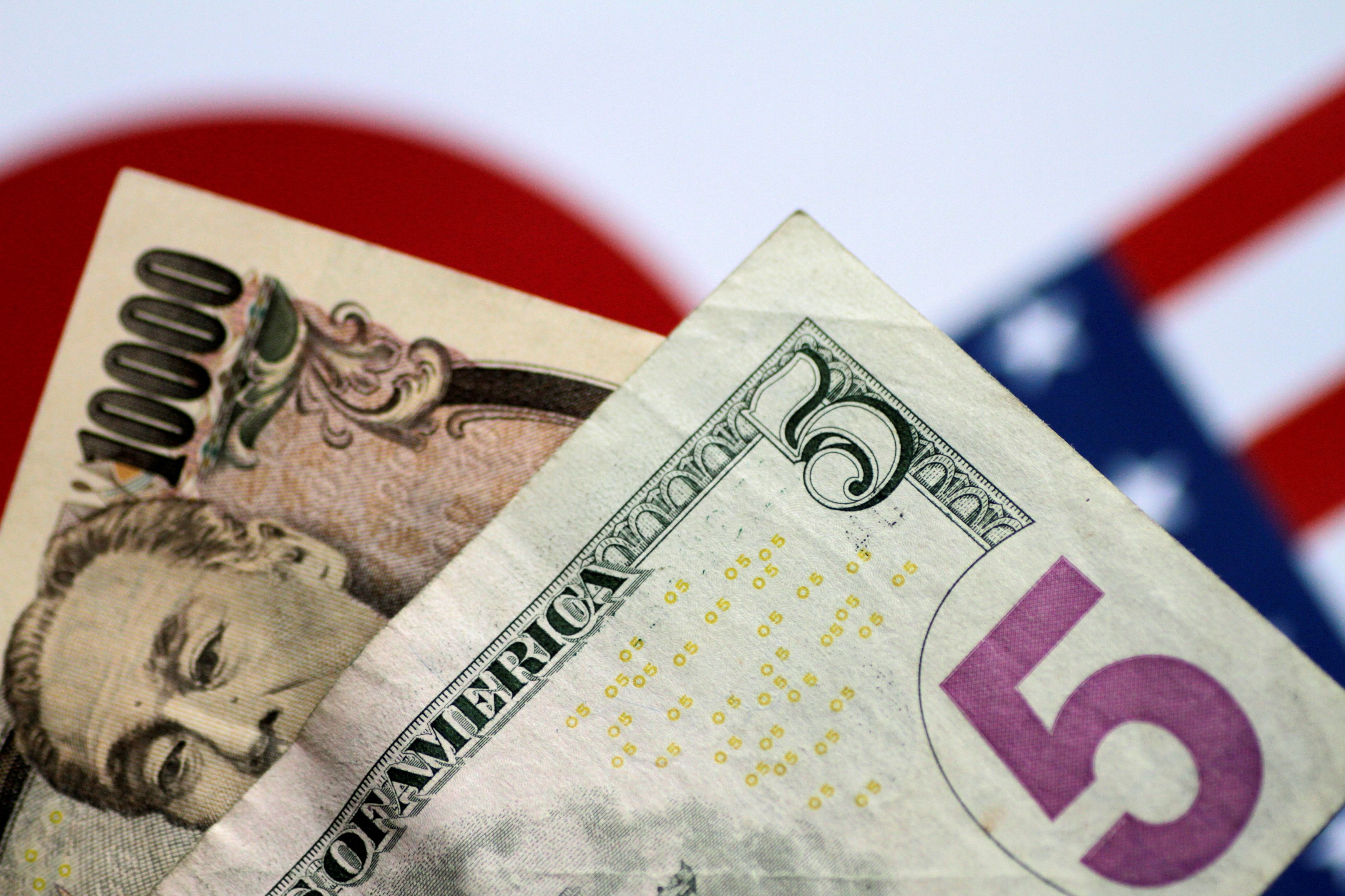 U.S. dollar and Japan yen notes are seen in this photo illustration June 2, 2017. REUTERS/Thomas White/Illustration