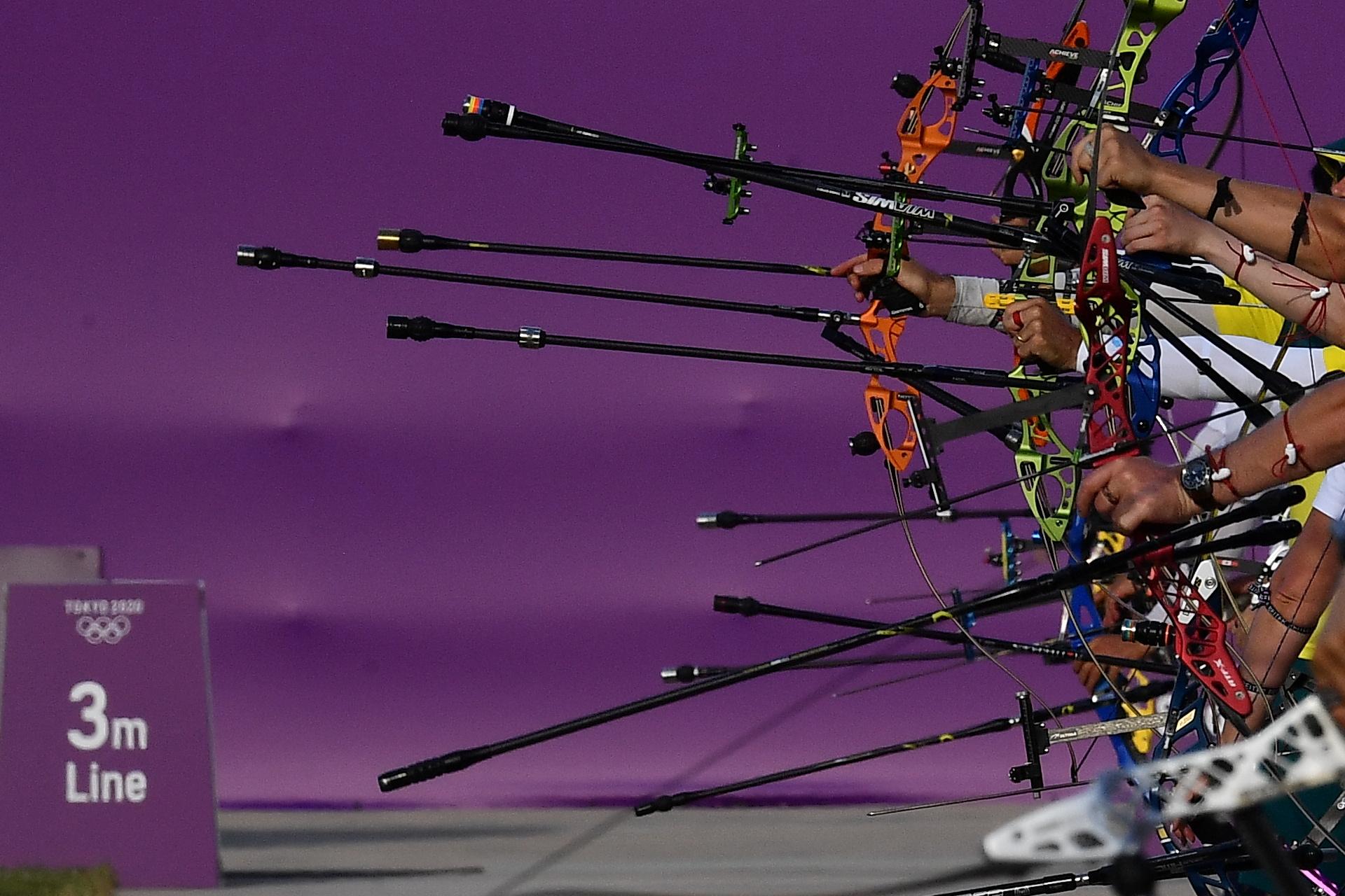 Tokyo 2020 Olympics - Archery Training Sessions - Yumenoshima Archery Field, Tokyo, Japan - July 21, 2021. Archers hold their bows during a day of ranking. REUTERS/Clodagh Kilcoyne
