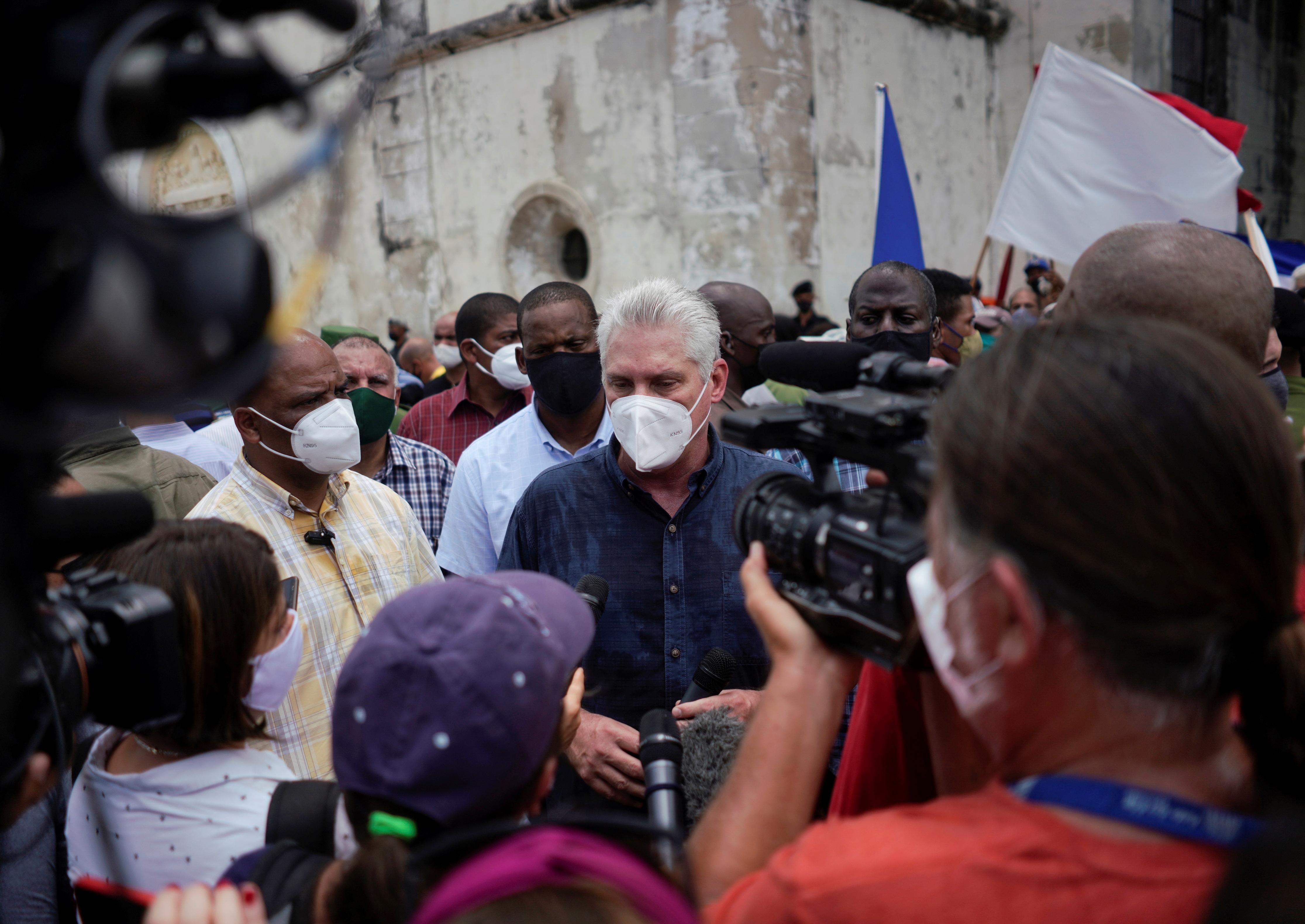 Cuba's President Miguel Diaz-Canel talks to the media, in San Antonio de los Banos, Cuba July 11, 2021. REUTERS/Alexandre Meneghini