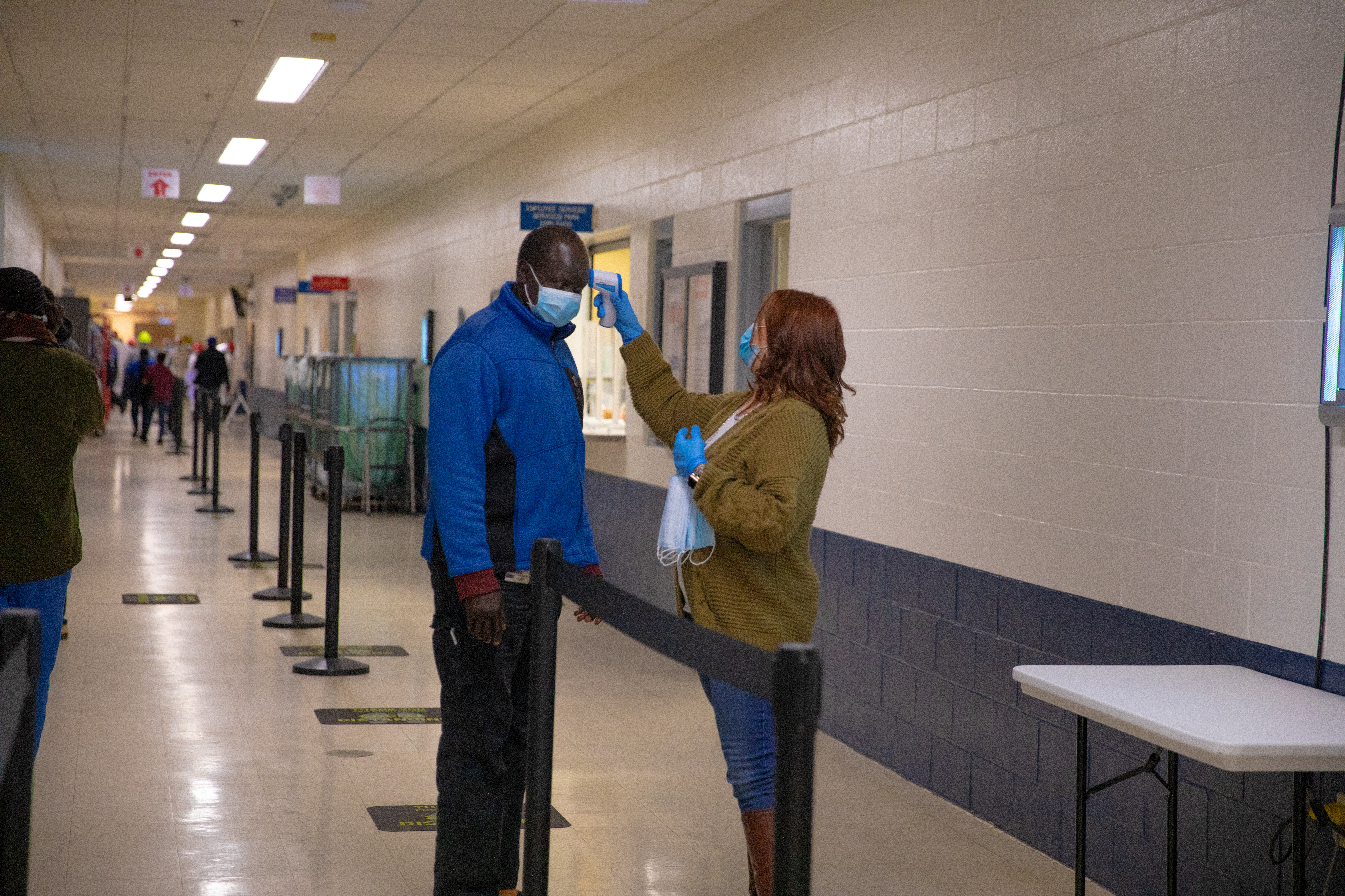 An employee has his temperature checked, part of the measures installed to help slow the spread of coronavirus disease (COVID-19) at the Seaboard Foods pork processing plant in Guymon, Oklahoma, U.S. May 8, 2020. Picture taken May 8, 2020. Seaboard Foods/Handout via REUTERS.